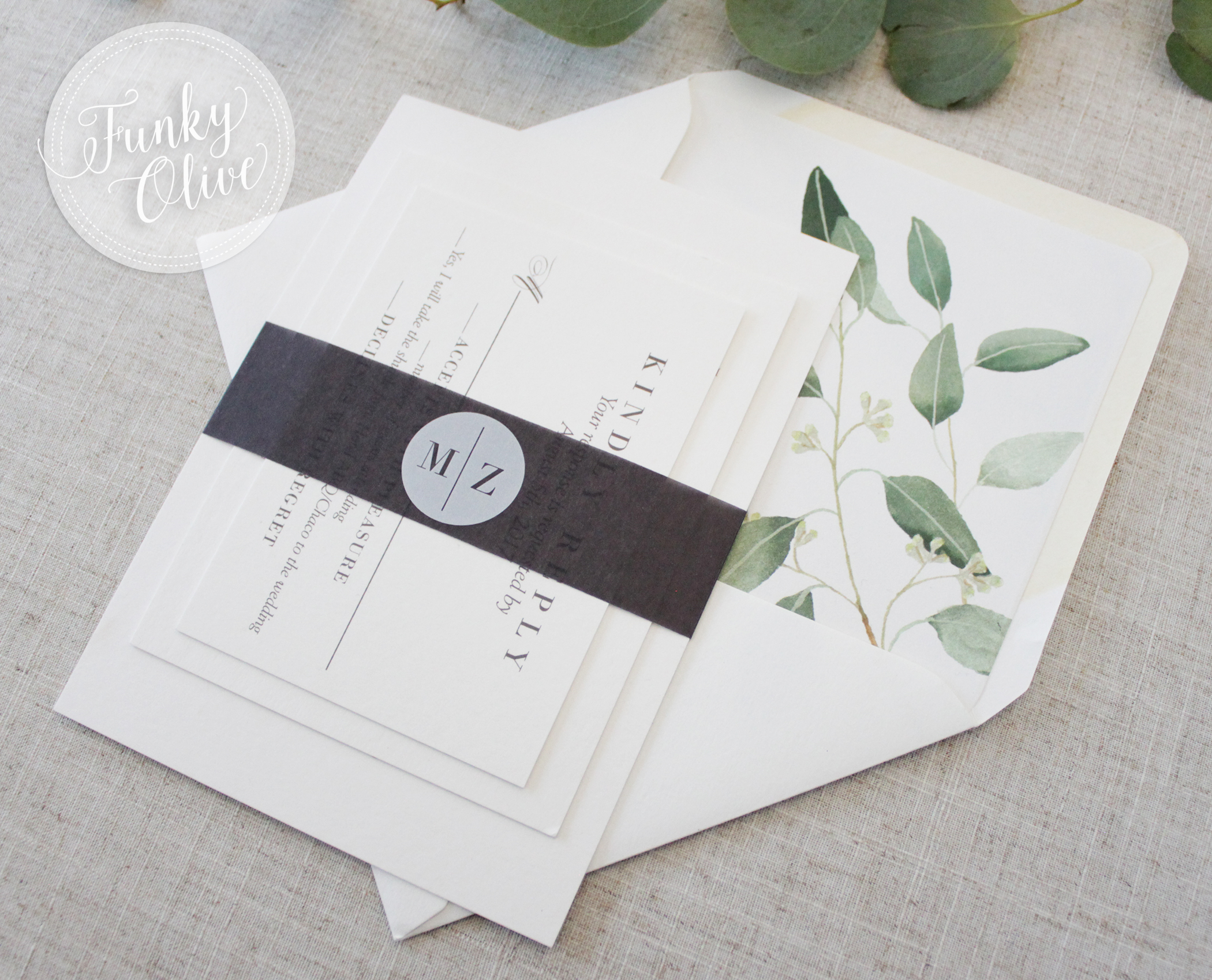 This simple and classicly styled belly band is made of soft black vellum (a thin, translucent paper), with suuuuper trendy white ink printing and a modern monogram.