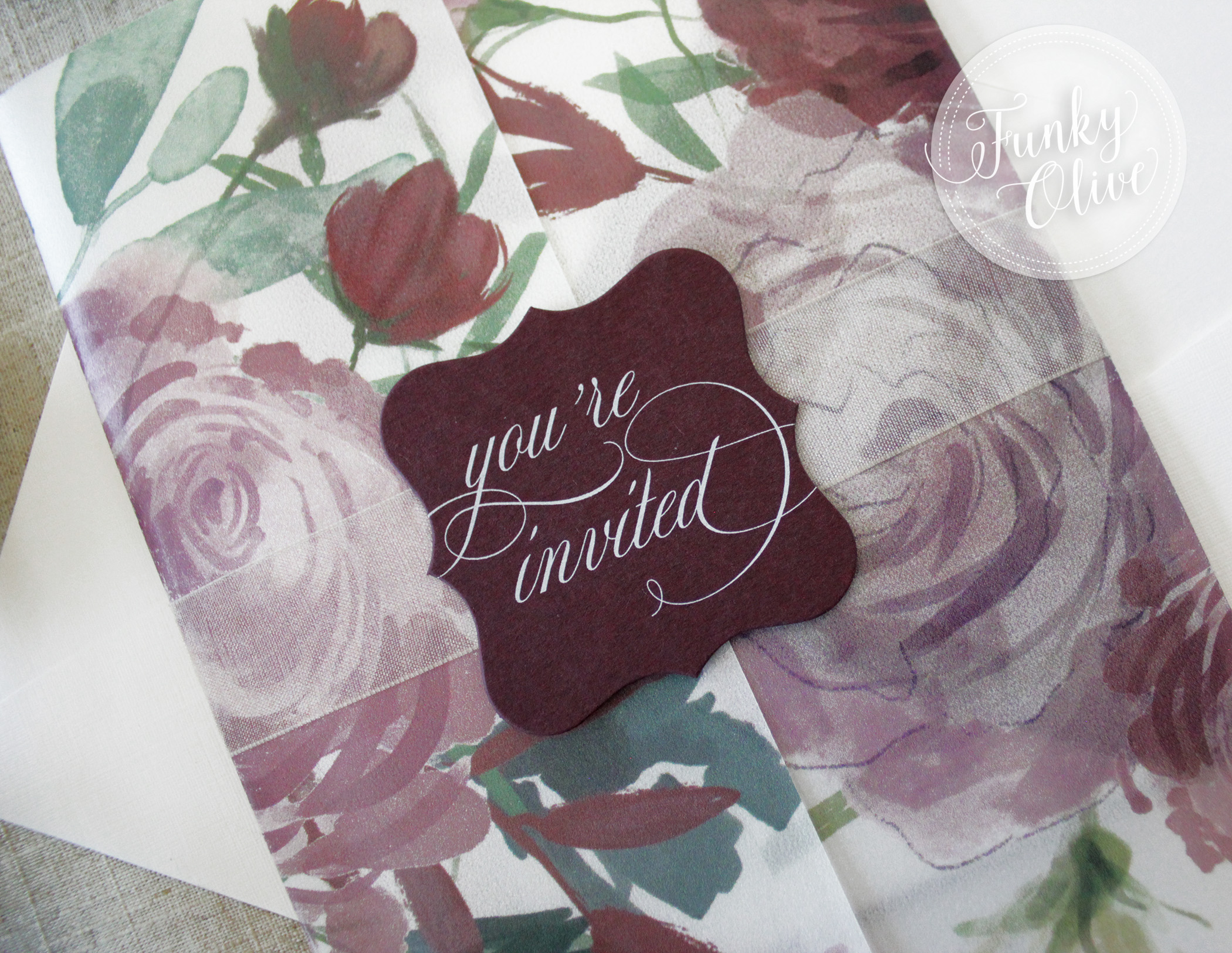 An Ivory sheer organza ribbon is the perfect pairing with this matte burgundy die cut topper and drool worthy white ink printing.