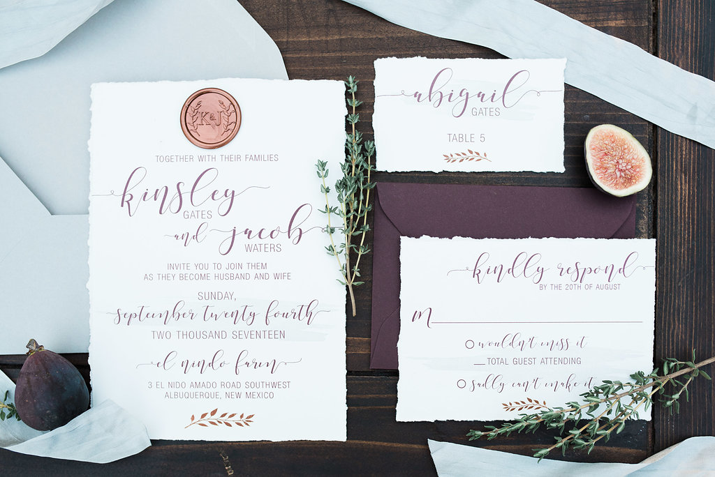 Placement is everything - here these perfect copper wax seals have been used as part of the invitation design, in a simple and chic way. Photo by the lovely  Briana Nicole Photography .