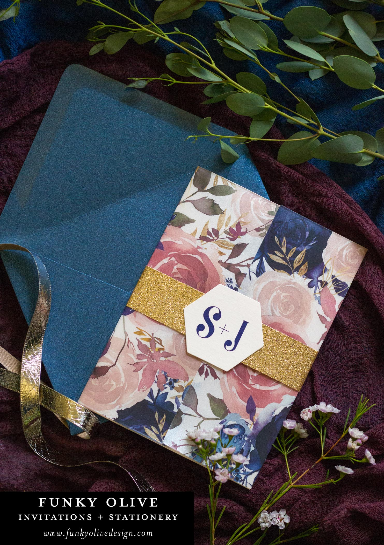 This vellum wrapped invitation suite in navy, blush and gold is sure to please!
