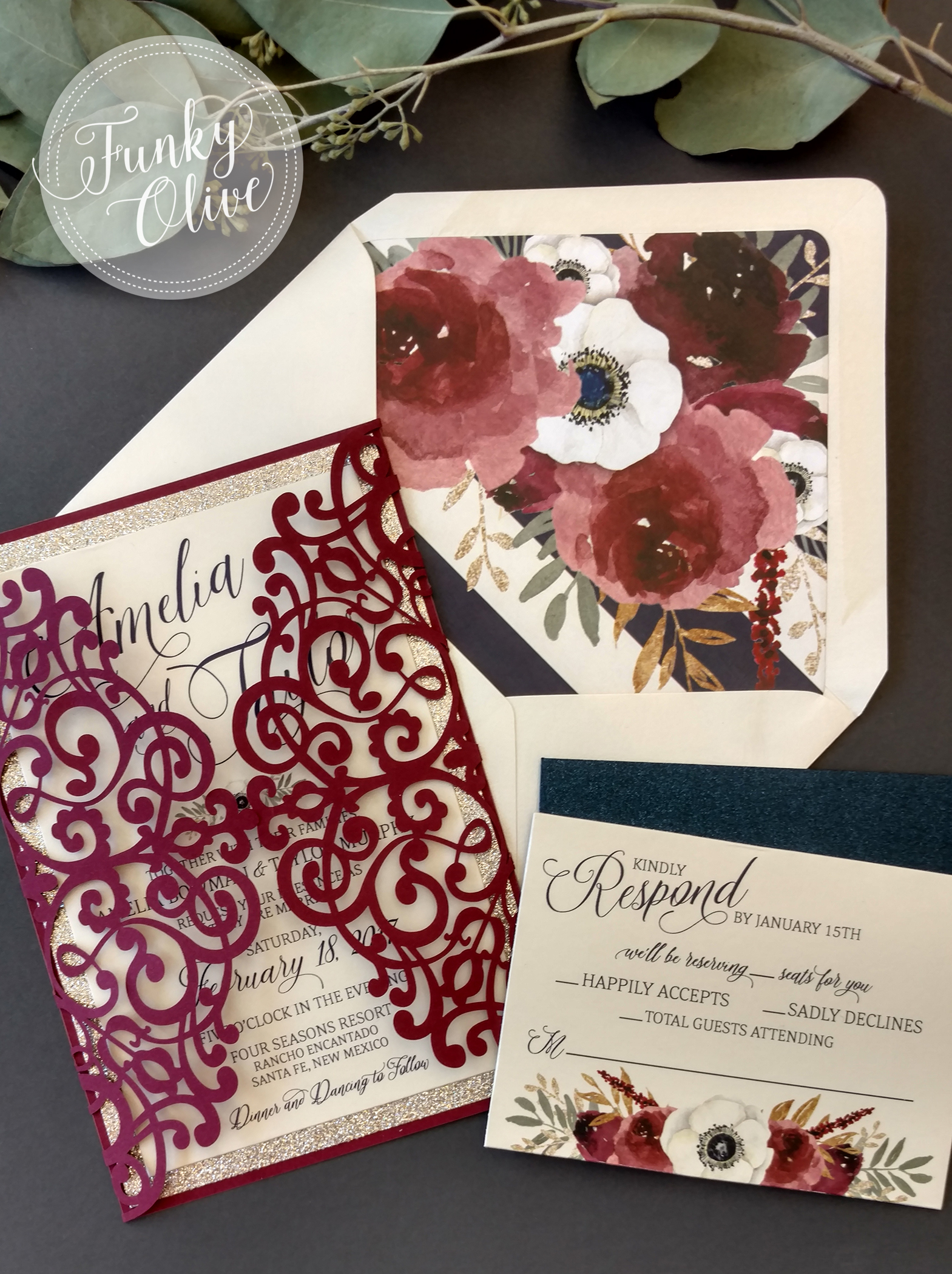 The navy plays well as our base ink color and as a bold striping on the floral envelope liner, while the sparkling navy response envelopes add the perfect balance to the burgundy laser cut enclosure.
