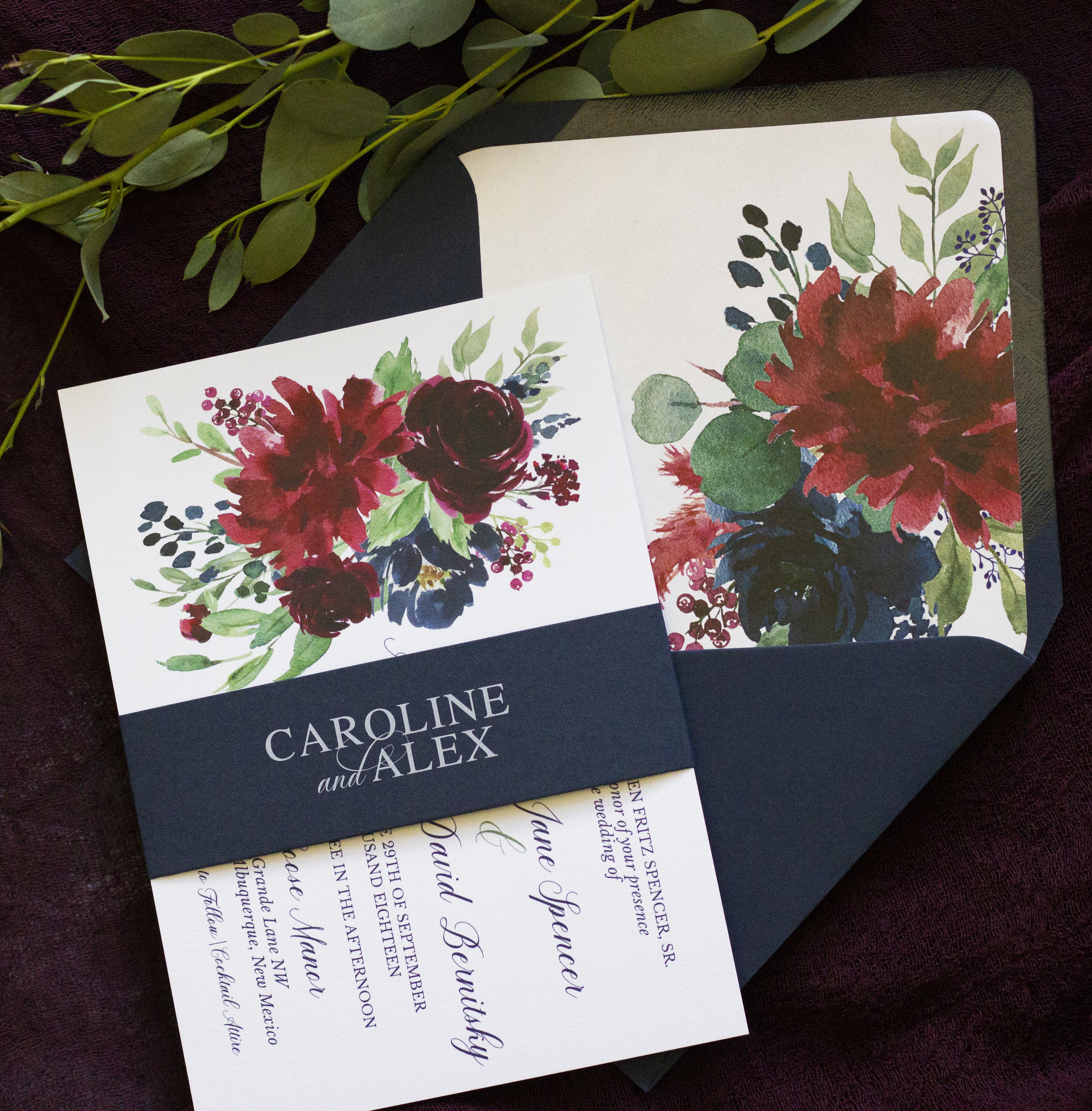 we're a little obsessed with the white ink on navy belly bands we created for Caroline & Alex, and the pop of florals on the liner of their navy envelopes!