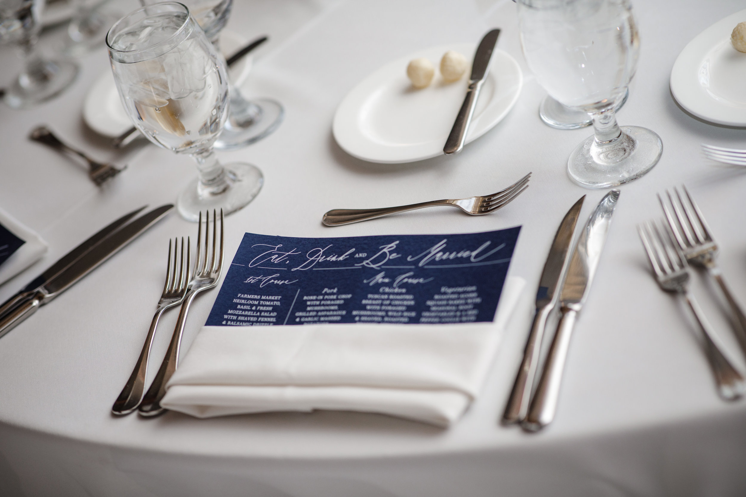 Jessica + Kino's navy with white ink reception menus were modern, fresh and romantic. Photo ©    Matt Blasing Photography