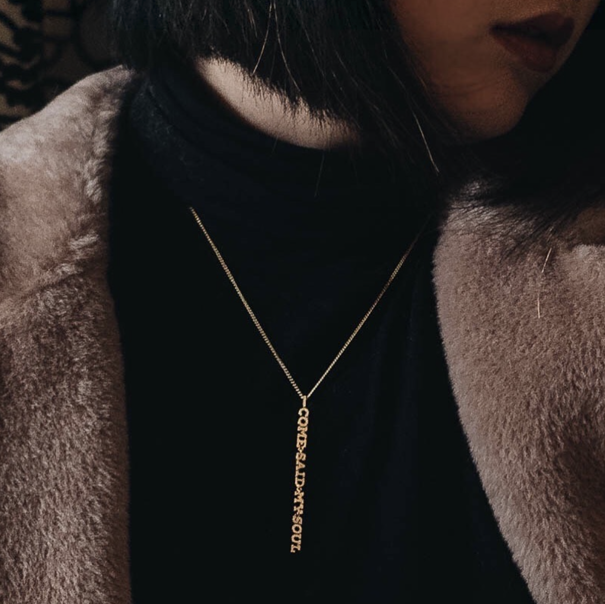 Maggie Zhu  wears her piece against a black top for added statement. See her post  here