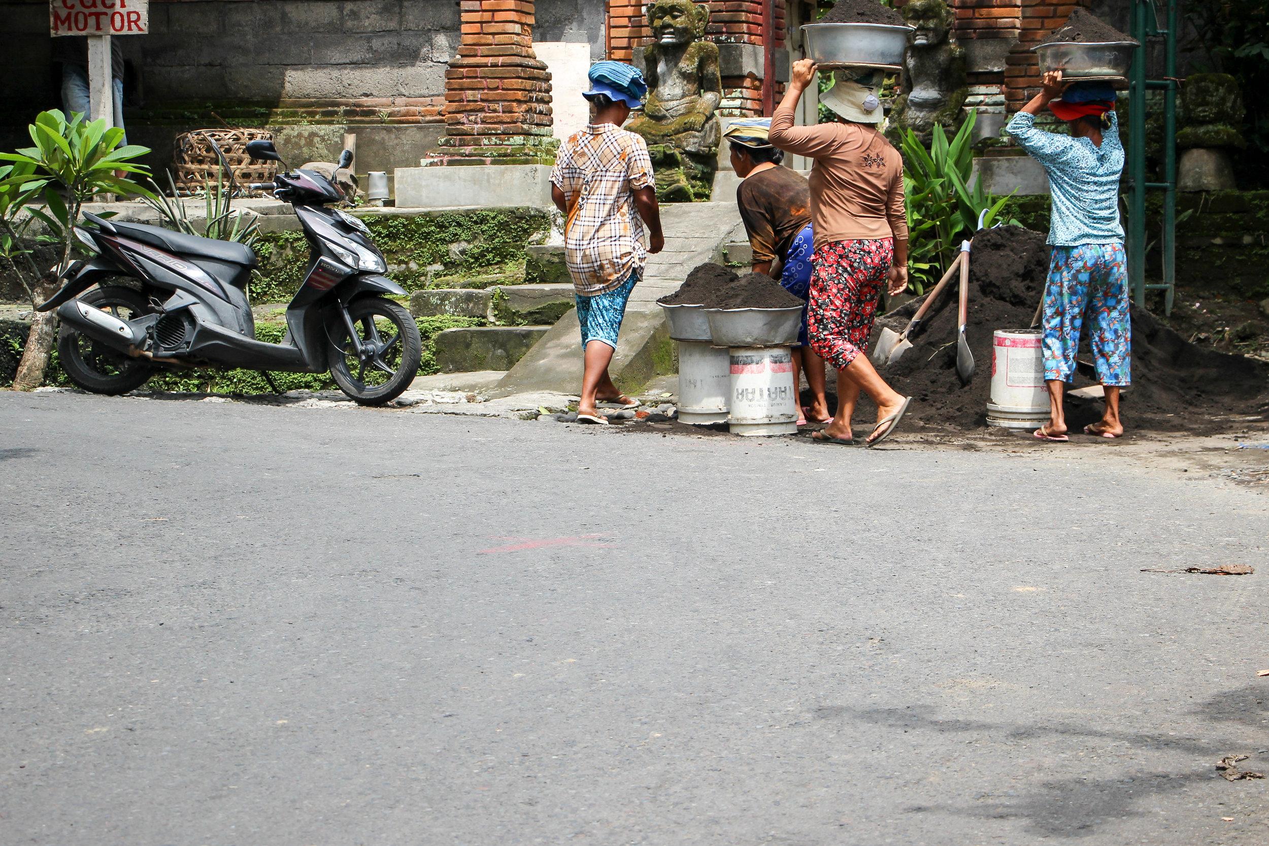WOMEN, FEMALE, CONSTRUCTION WORKERS, BALI, INDONESIA, ASIA | DOLESSGETMOREDONE.COM |