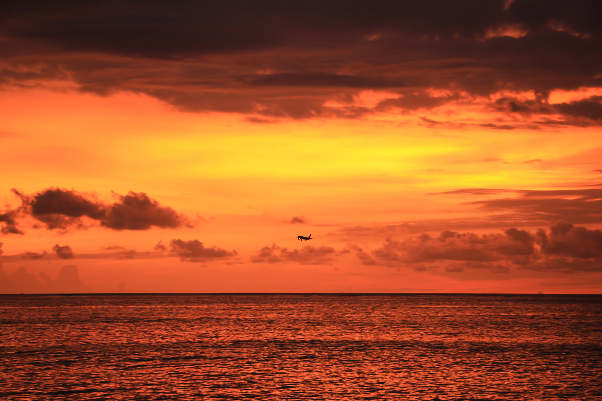 sunset, sky, clouds, sea, airplane, Bali, Indonesia, Asia | DoLessGetMoreDone.com |