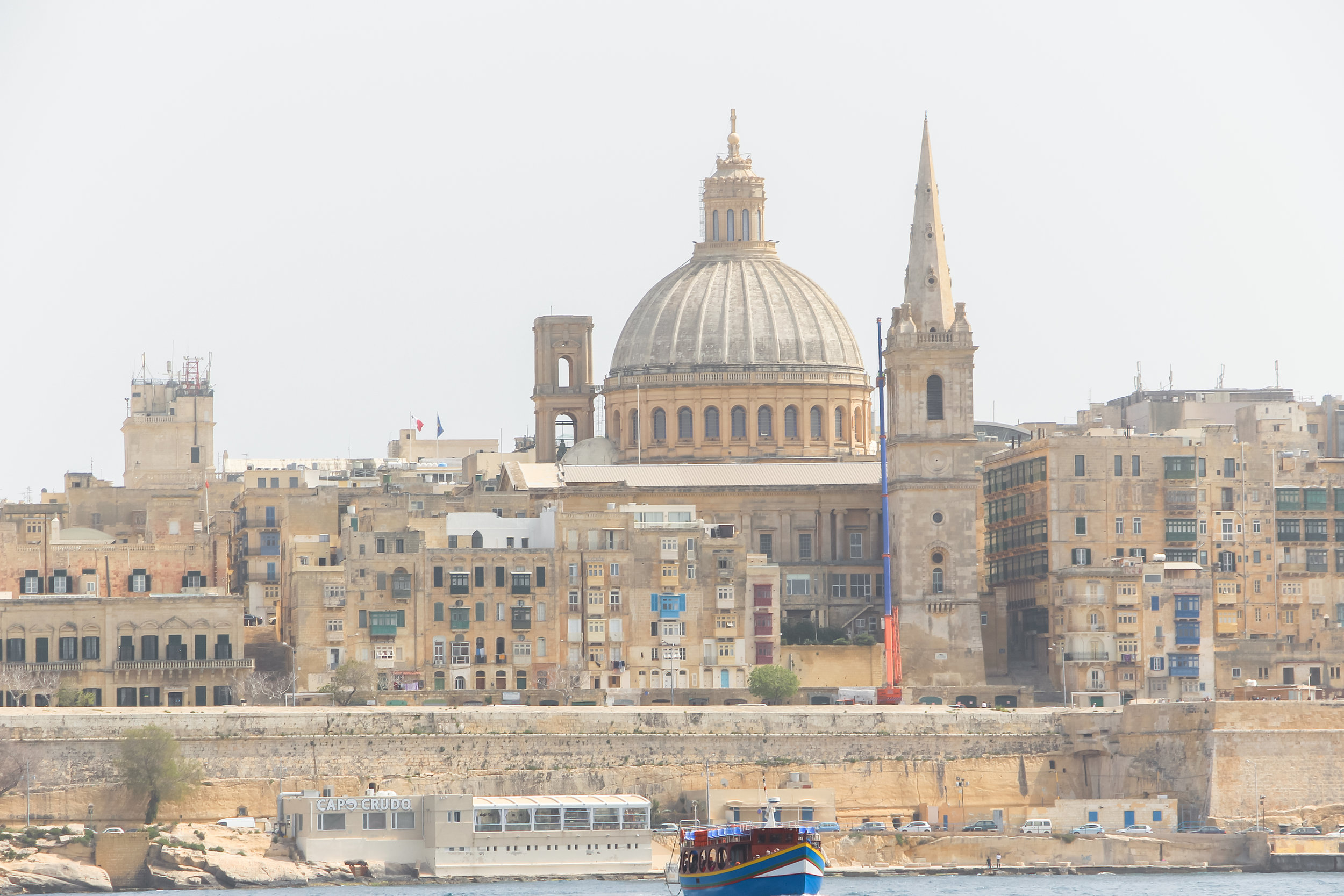 Old Town of Valletta | Carmelite Church, the tower of St Paul's Pro-Cathedral | and the Mediterranean Sea | - Thinking about appreciation for quality in Malta | Malta, Europe | DoLessGetMoreDone.com | - Canon Minimal Travel Documentary Photography - search for liveability | Sustainability