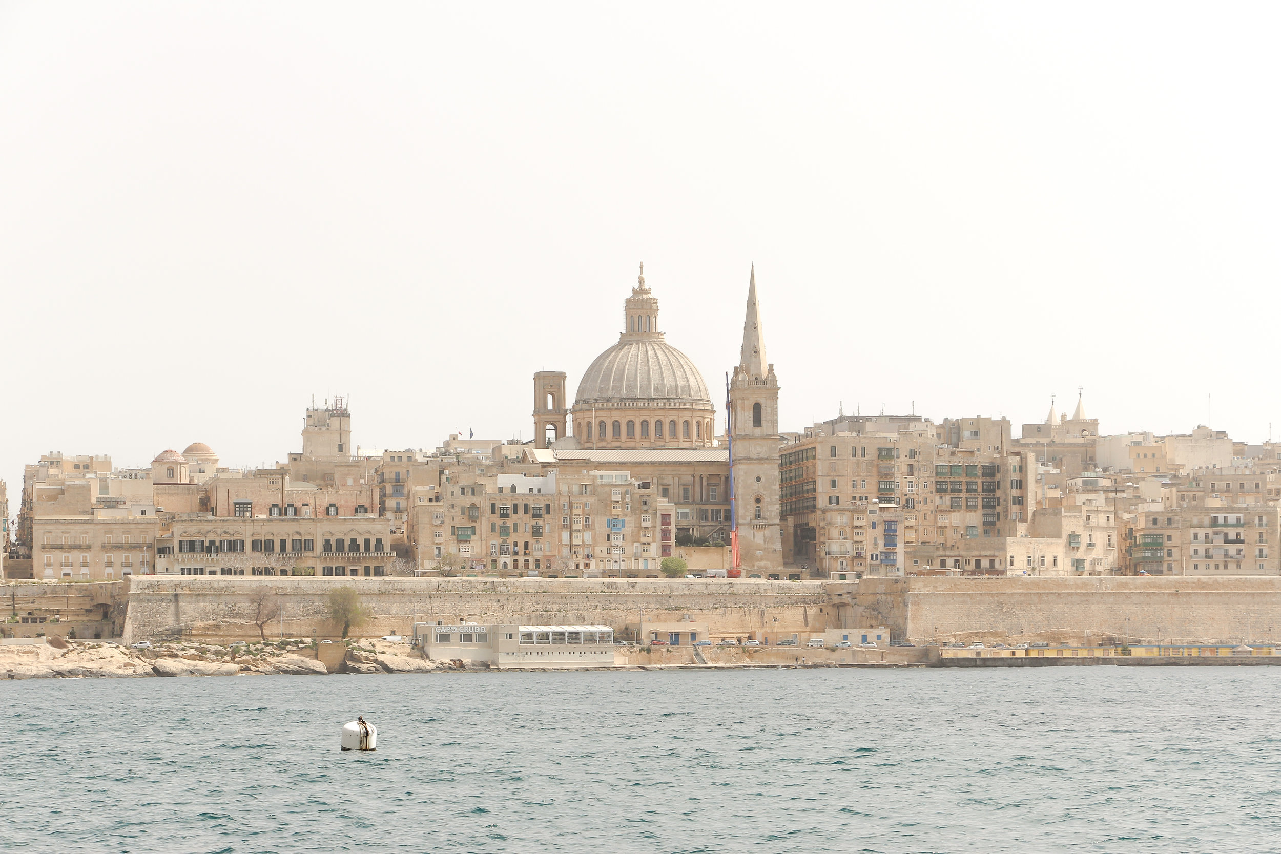 Old Town of Valletta | Carmelite Church, the tower of St Paul's Pro-Cathedral | and the Mediterranean Sea | - Thinking about appreciation for quality in Malta | Malta, Europe | DoLessGetMoreDone.com | - Canon Travel Documentary Photography - search for liveability | Sustainability