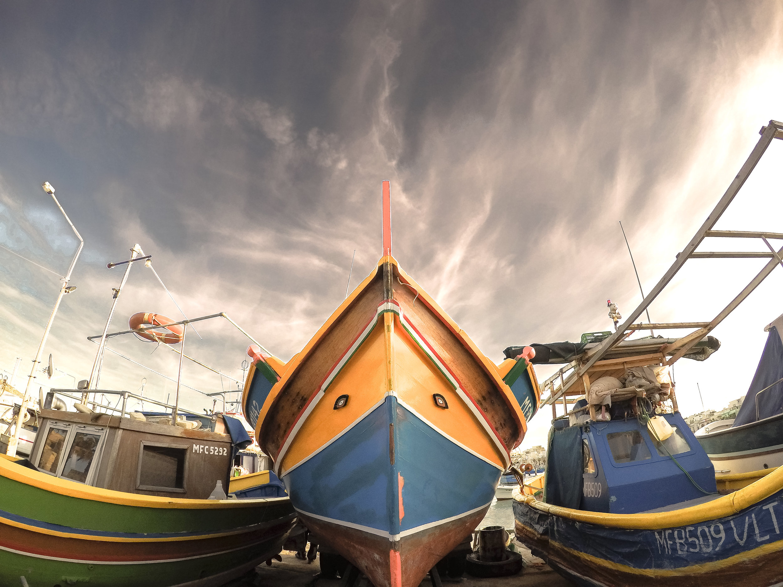 Maltese Boats | Traditional Fishing Village | Mediterranean Sea | Marsaxlokk - Thinking About Appreciation For Quality In Malta | Malta, Europe | DoLessGetMoreDone.com | - GoPro Minimal Travel Documentary Photography - search for Liveability | Sustainability