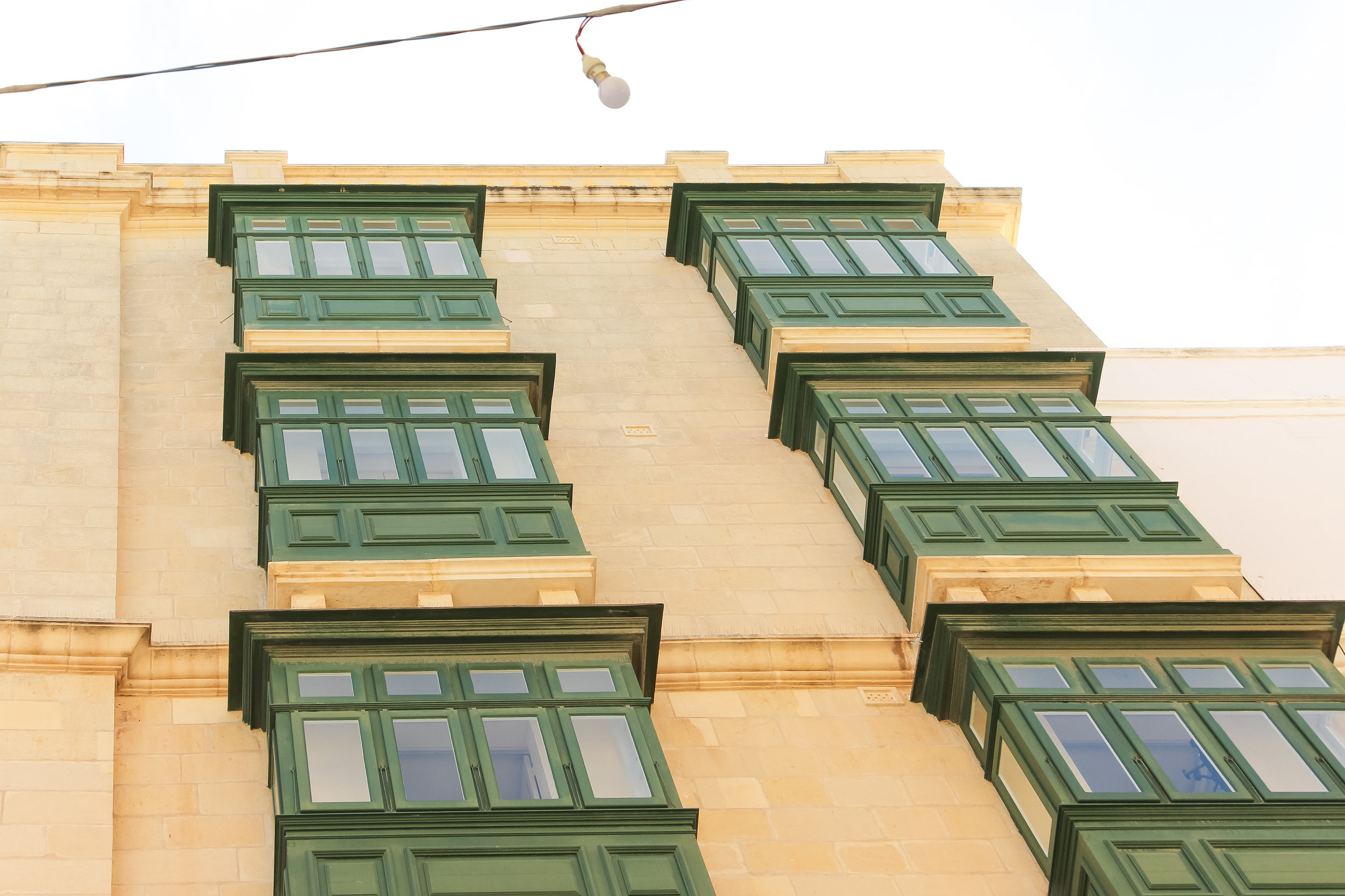 Maltese windows   House of Malta, Green Traditional Enclosed Wooden Balcony   Old Town of Valletta   - Thinking About Appreciation For Quality In Malta   Malta, Europe   DoLessGetMoreDone.com   - Canon Minimal Travel Documentary Photography - search for Liveability   Sustainability
