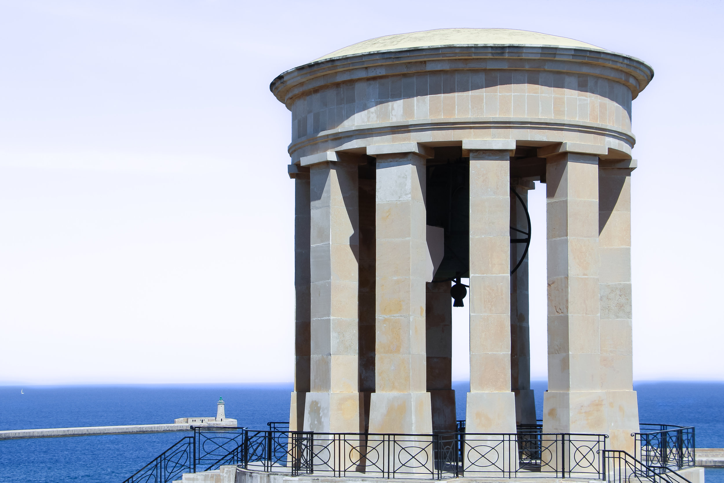 Siege Bell Monument | Grand Harbour Lighthouse | the Mediterranean Sea | Valletta | - Thinking About Appreciation For Quality In Malta | Malta, Europe | DoLessGetMoreDone.com | - Canon Minimal Travel Documentary Photography - search for liveability | Sustainability