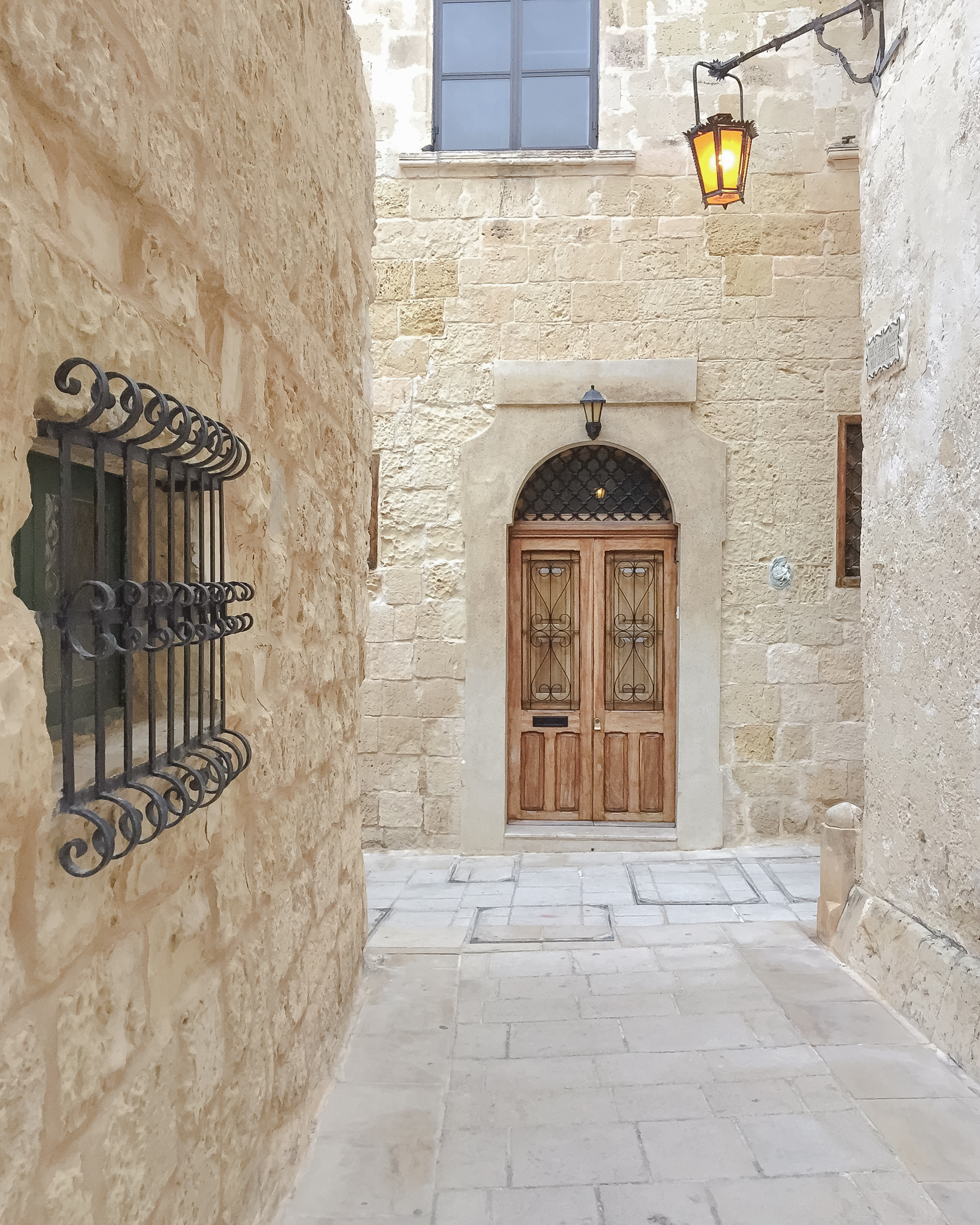 Maltese Door | Window | Street Light | Streets of Malta | Mdina | - Thinking About Appreciation For Quality In Malta | Malta, Europe | DoLessGetMoreDone.com | - Minimal Travel Documentary Photography - search for Liveability | Sustainability