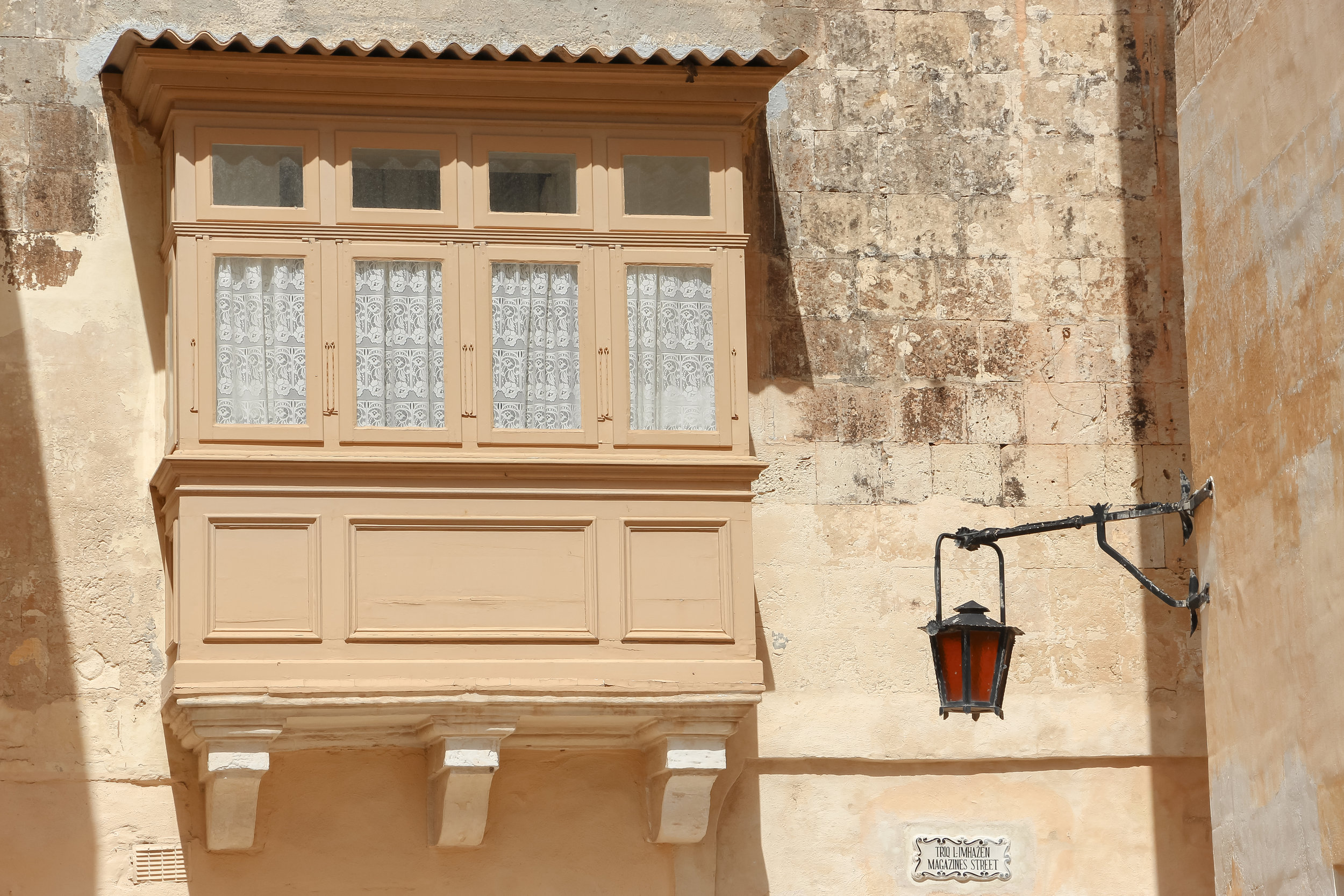 Streets of Malta | Traditional Enclosed Wooden Balcony, Maltese window, Street Light | Mdina | - Thinking About Appreciation For Quality In Malta | Malta, Europe | DoLessGetMoreDone.com | - Canon Minimal Travel Documentary Photography - search for Liveability | Sustainability