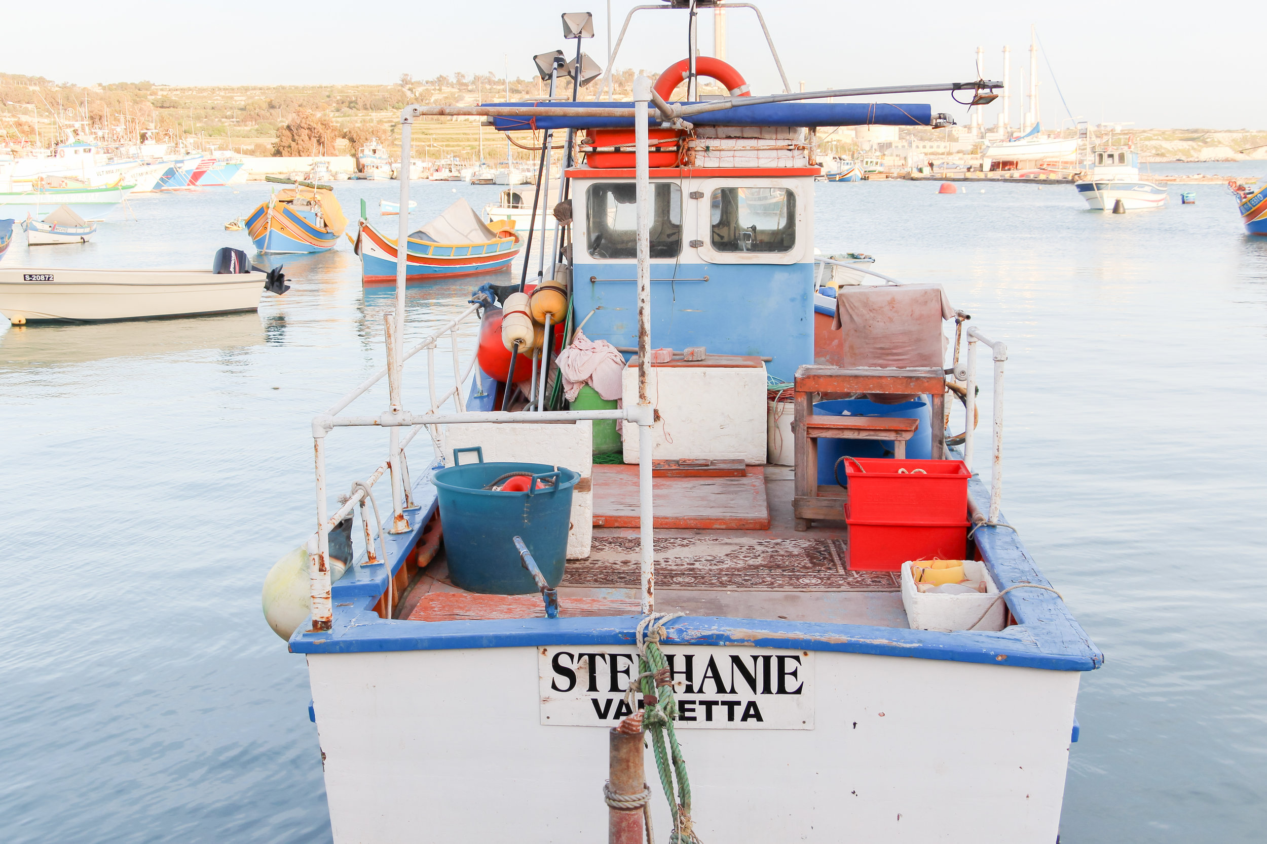 Maltese Boats | Traditional Fishing Village | Mediterranean Sea | Marsaxlokk - Thinking About Appreciation For Quality In Malta | Malta, Europe | DoLessGetMoreDone.com | - Canon Minimal Travel Documentary Photography - search for Liveability | Sustainability