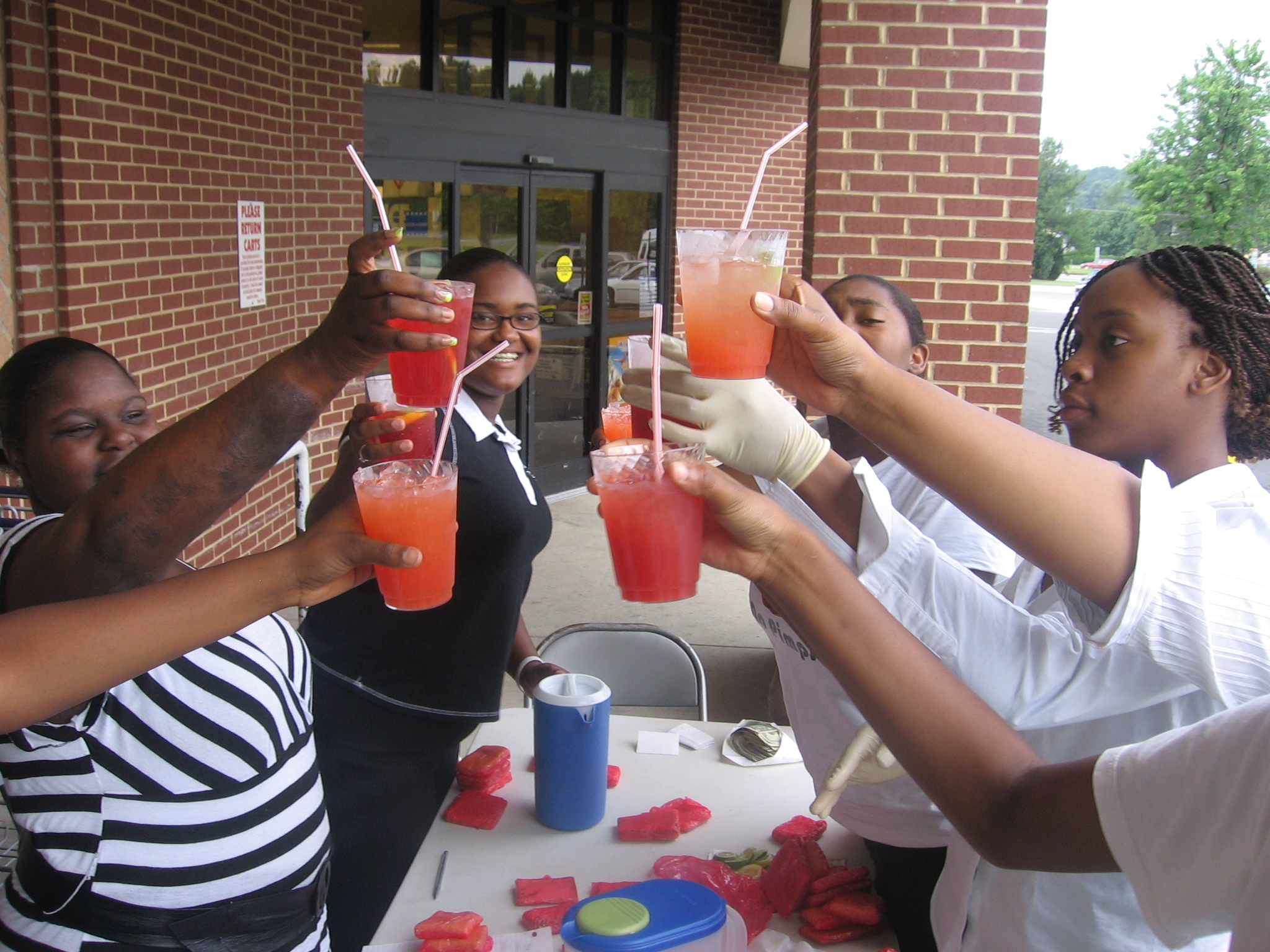 our young entrepreneurs cheering to a successful lemonade stand...how cool & refreshing!!!