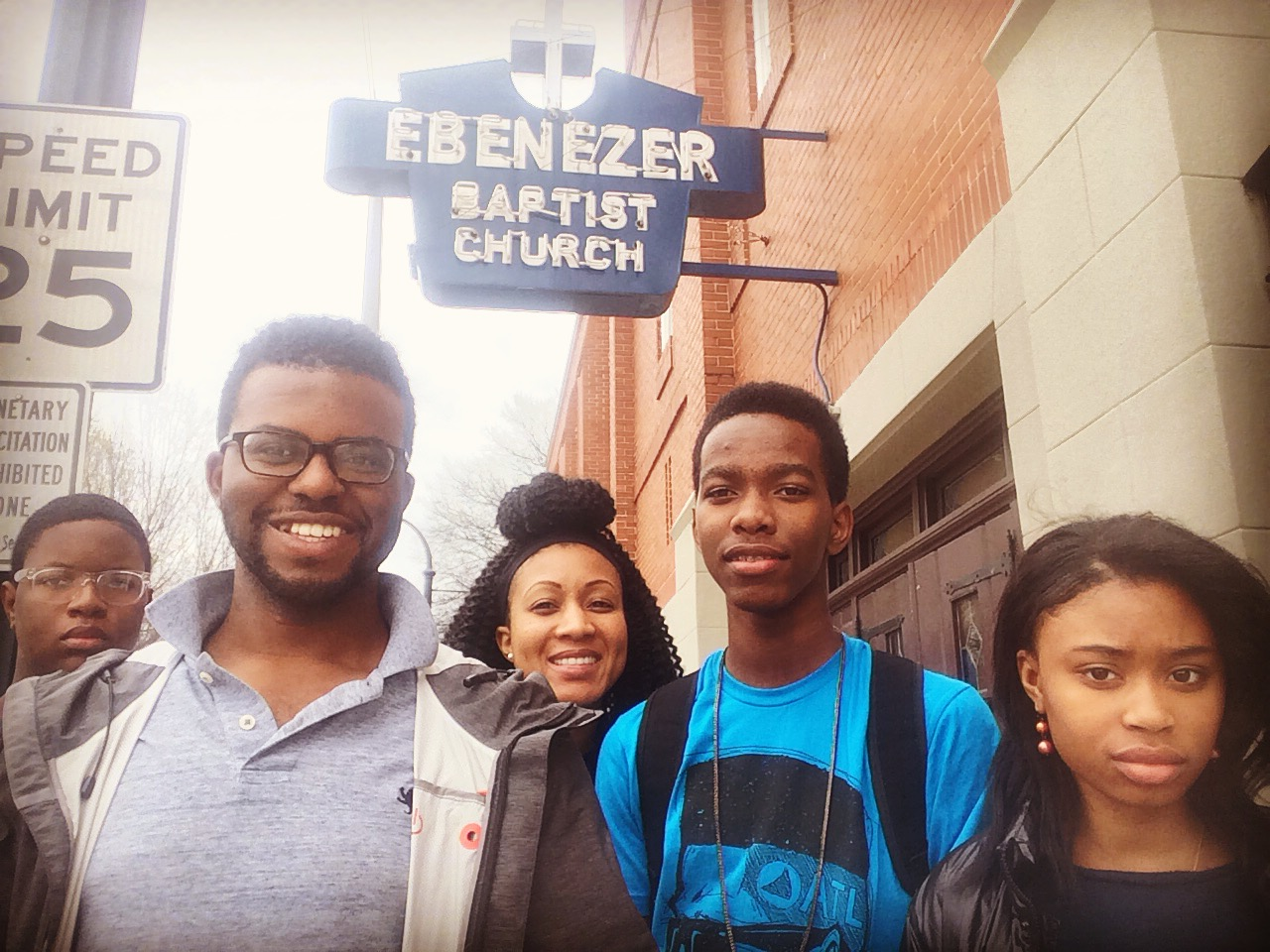 Liz (center) with Jahzamire (far right) and other members of Urban Hope's Young Leaders Group visiting the church where Dr. Martin Luther King, Jr. was baptized and ordained.