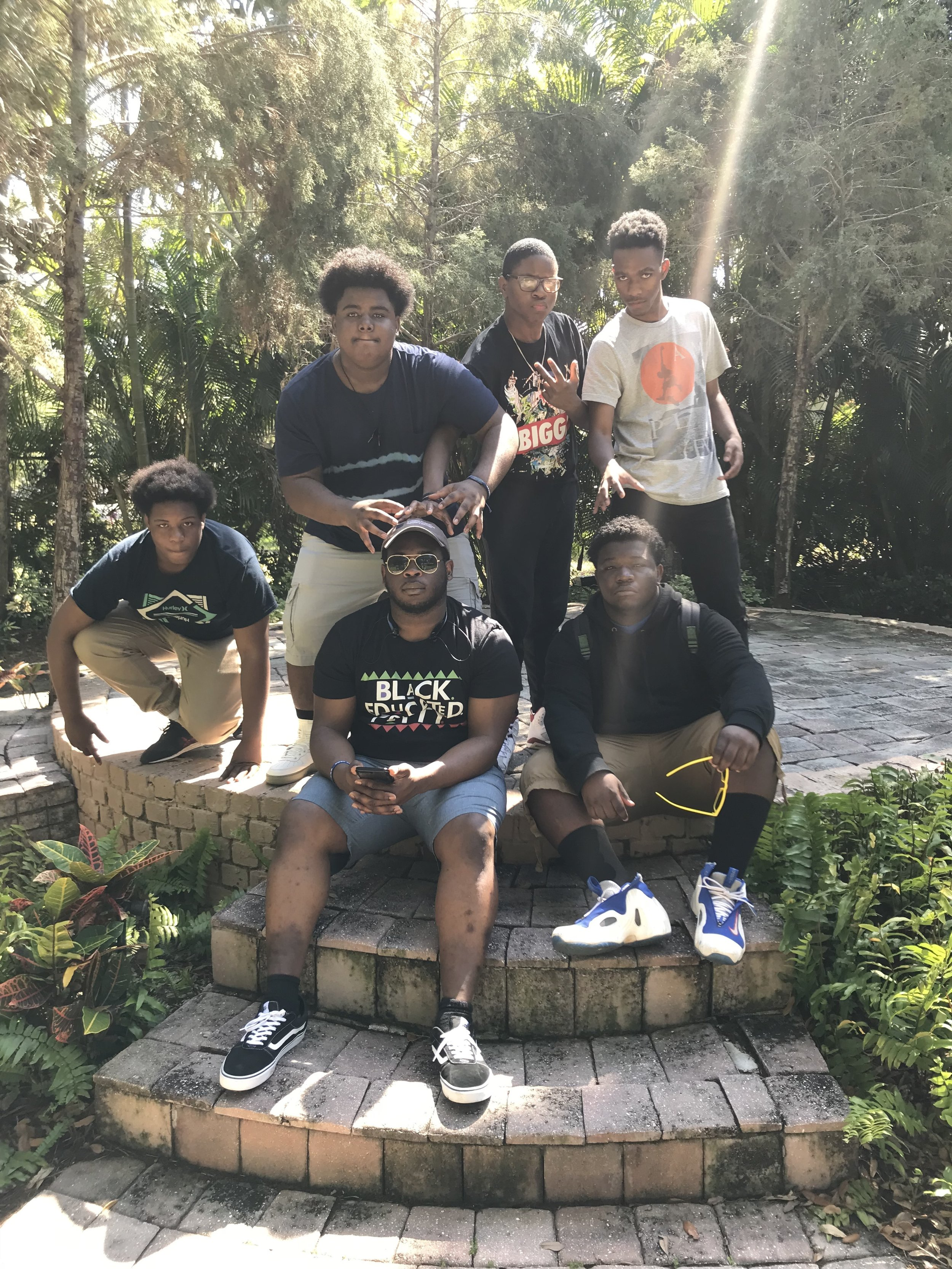 Robert (center) hanging with some young heroes at the Carter G. Woodson African-American Museum's Legacy Garden on a recent spring break service trip to Tampa, Florida