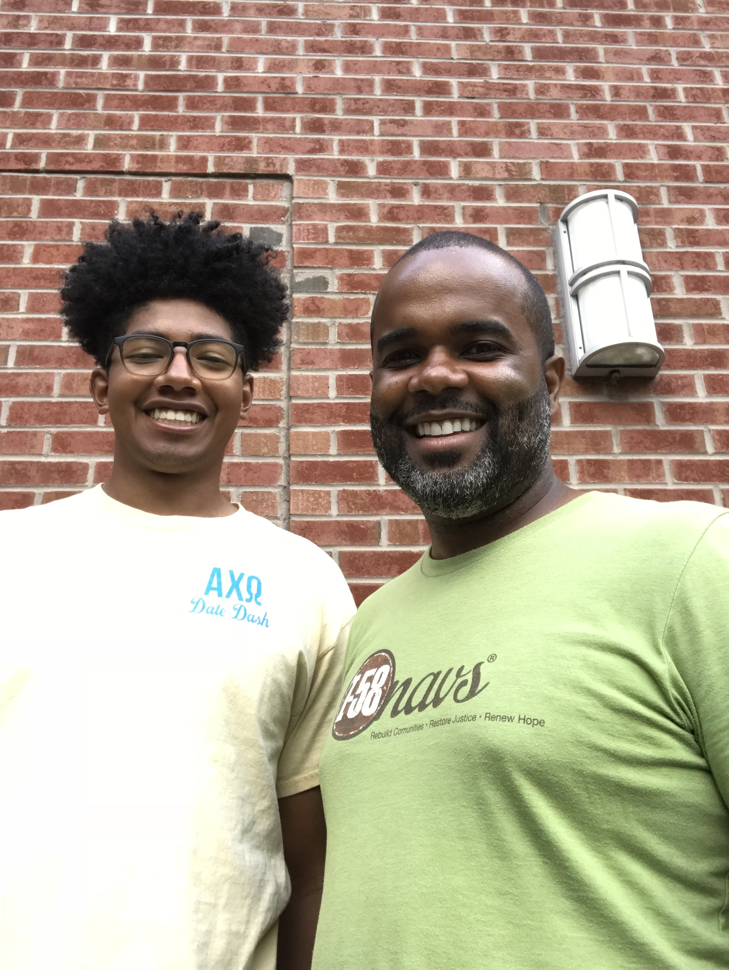 Xavier (left) and Urban Hope director, Brandon Hudson, posing outside the UH office at Blacknall Presbyterian Church, their go to spot for ministry planning and theological reflection