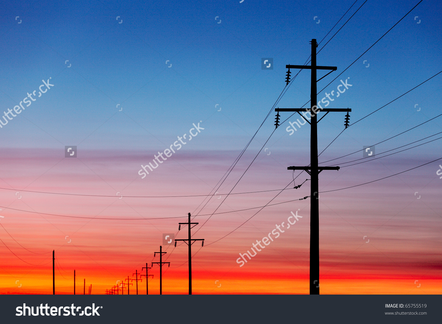 stock-photo-a-silhouette-of-high-voltage-power-lines-against-a-dramatic-and-colorful-sky-at-sunrise-or-sunset-65755519.jpg