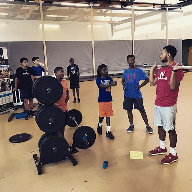 Coach Truth demonstrating barbell exercises 🏋️♀️