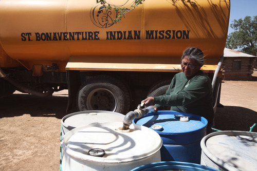 A woman delivers clean water in Navajo communities. Photo via  http://digdeeph2o.tumblr.com/ .