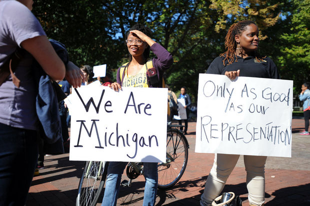 Michigan students raise awareness on campus of a decline in minority enrollment.  Photo via mlive.com