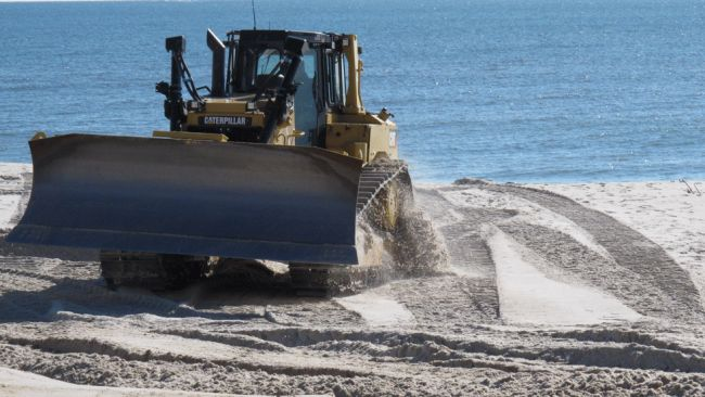 A bulldozer works on a New Jersey beach.