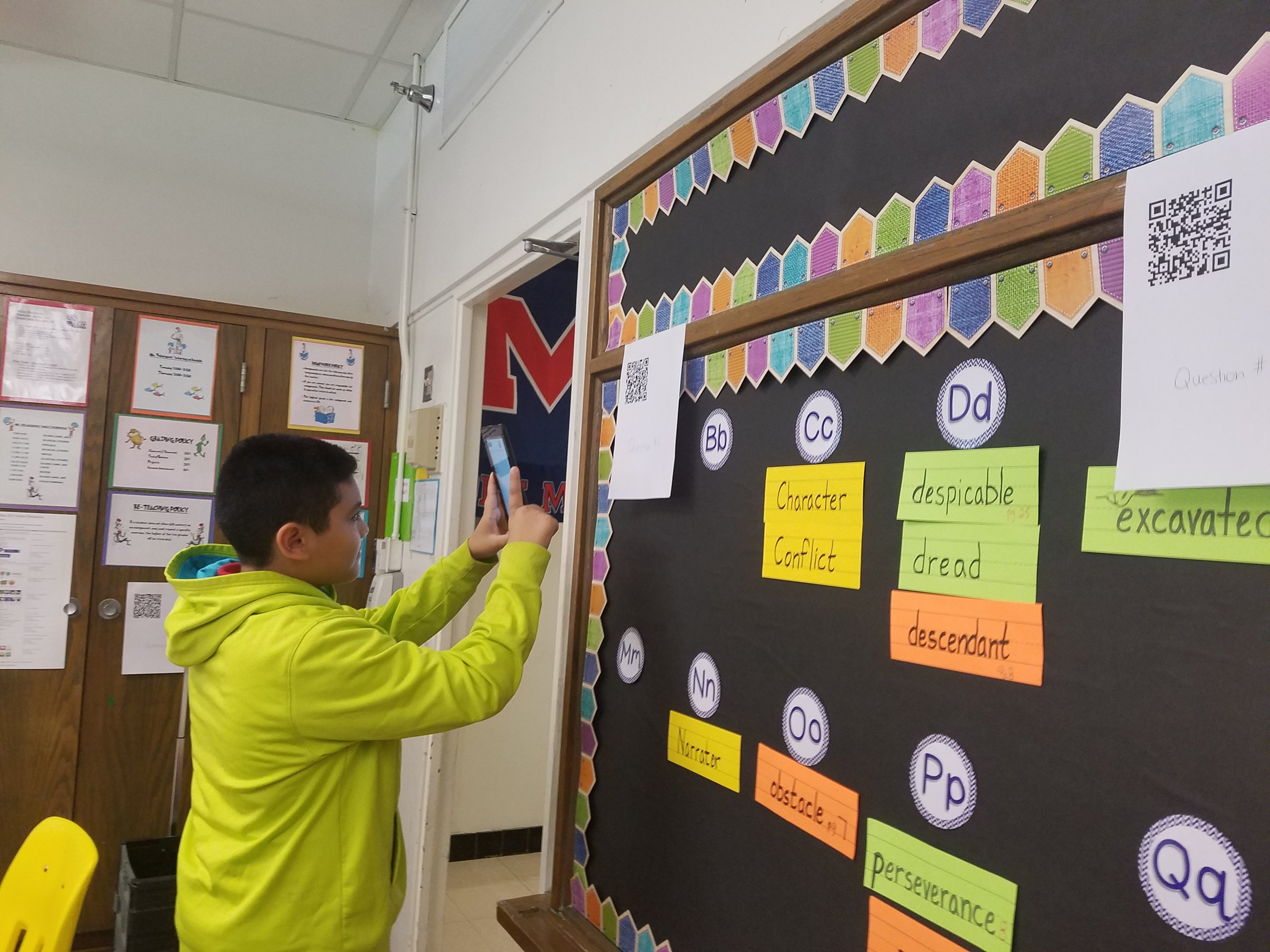 5th grade student at Reilly Elementary using a QR code to access the next part of their class activity.