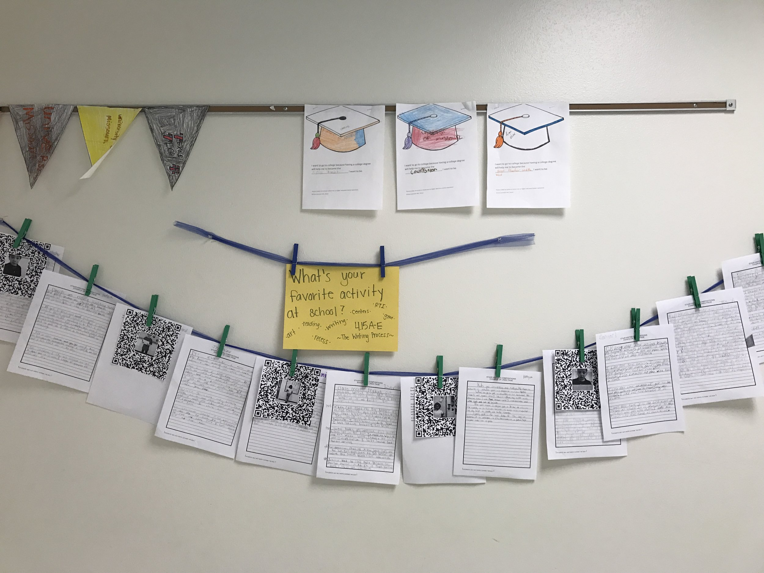 This teacher used their bulletin board to show off student work with QR codes that link you to an audio clip of the student reading their story.