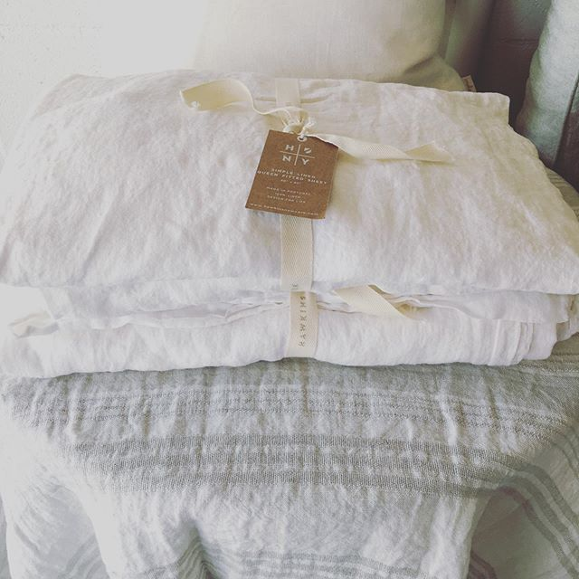 Luxurious linen bedding and throws. • Sheets available to order in other colors. . . . . . #linenbedding #linens #linen #linensheets #linenthrow #ohsosoft #comfycozy #belgianlinenthrow #textiles #homedecor #bedding #shoplocal #shoptampa #southtampaboutique #bluemoontradingco