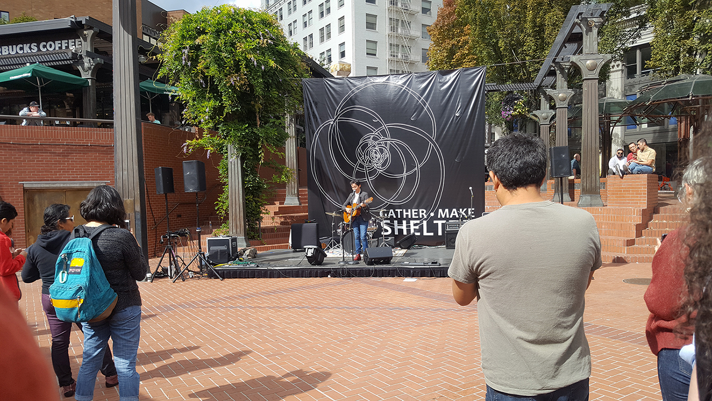 A woman performs at Gather Make Shelter, a public event about homelessness and poverty, in Pioneer Square in downtown Portland, Oregon.