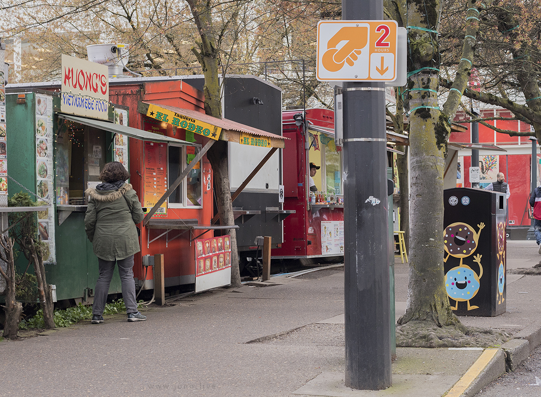 This is a view of a group of food trucks, or food carts, in downtown Portland, Oregon.   Food trucks and street foods are popular in Oregon.