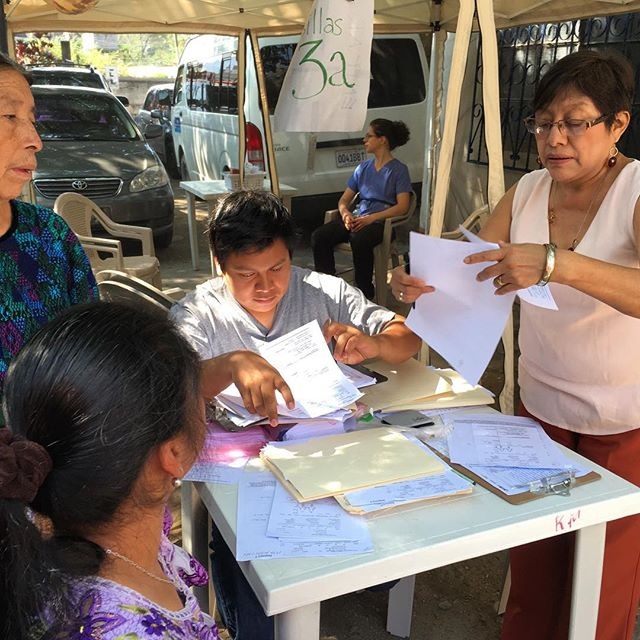 Helen and Gerardo keep registration moving during IHP's April volunteer acupuncture mission to Panajachel Guatemala