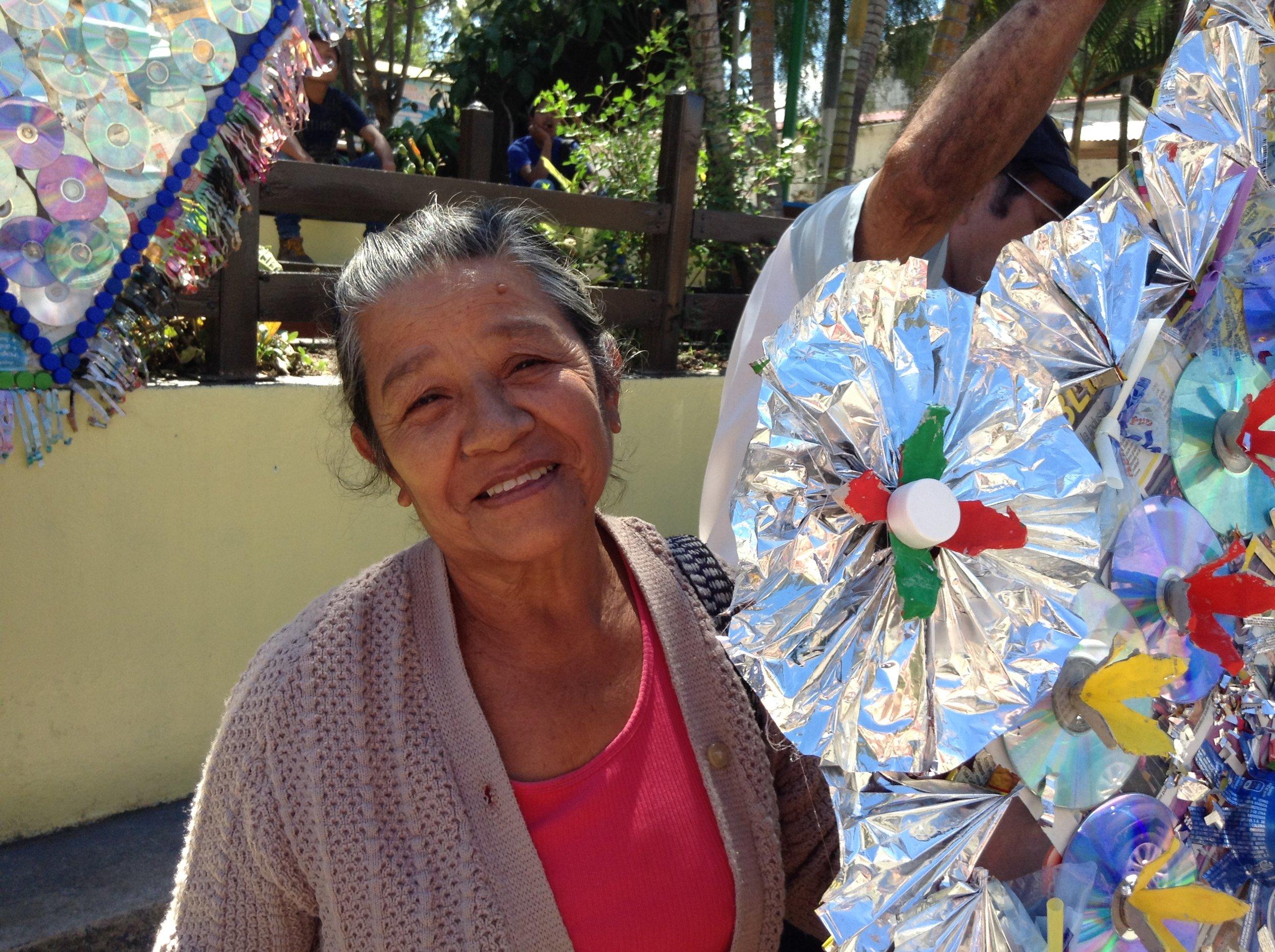 Elida Abandano of SOSEP - Anos Dorado enjoys recycled kite exhibit in Panajachel