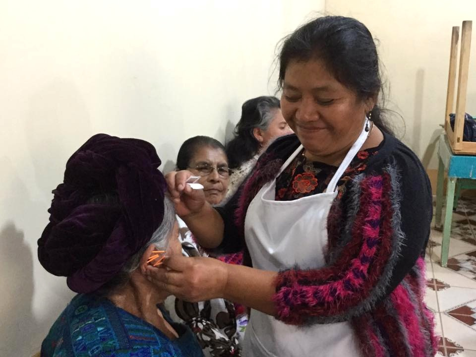 Juana Busch treats patient in one of the twice weekly clinics at the Centro de Salud in Panajachel