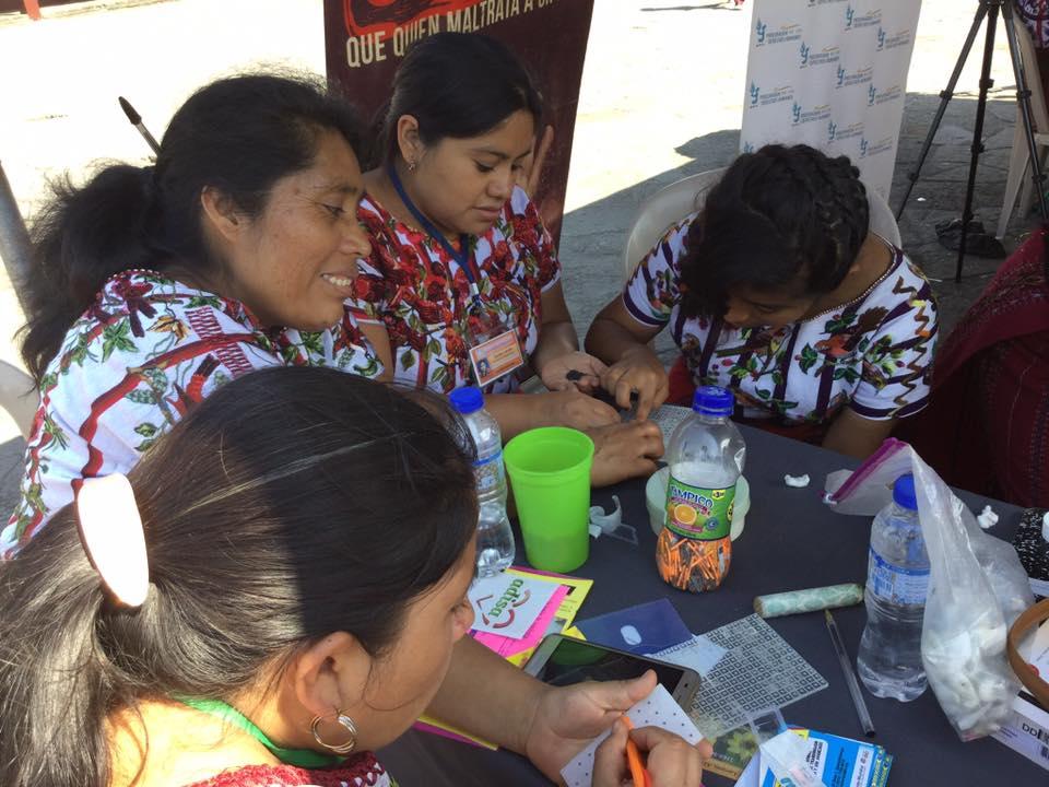 Labor intensive, but economical: volunteers make ear seeds for application.