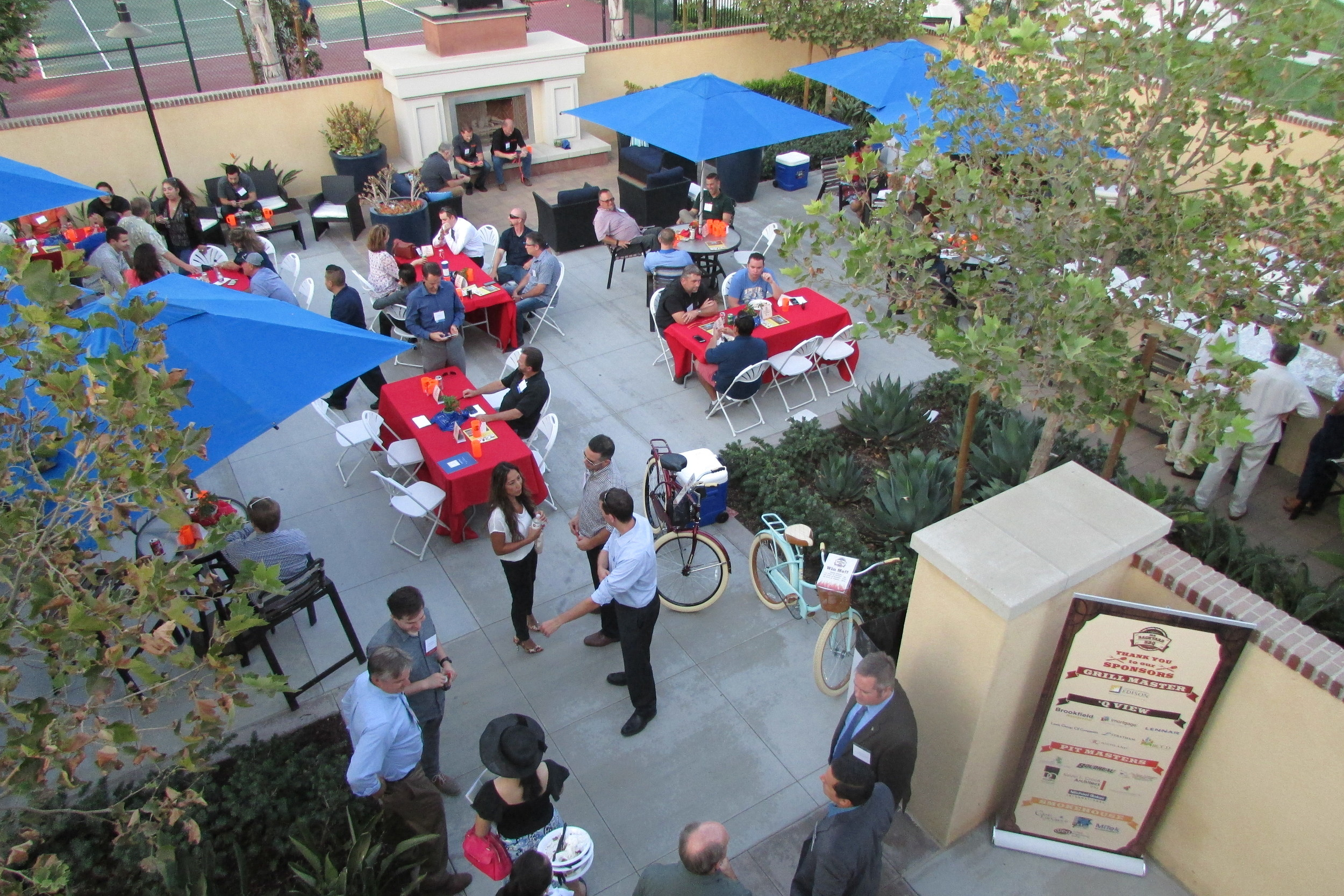 Almost 200 attendees networking while enjoying delicious BBQ at the 2016 Backyard BBQ