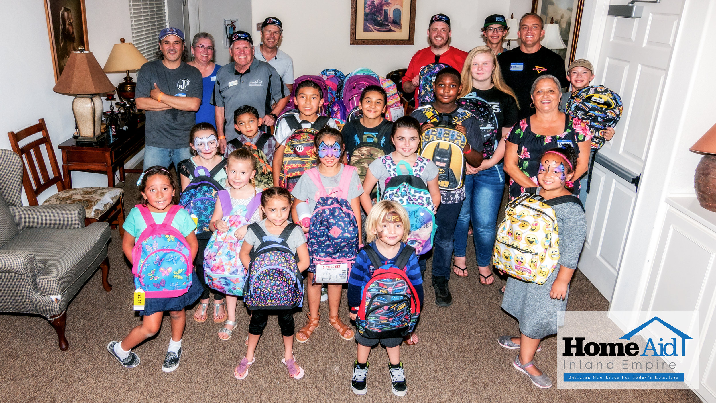 HomeAid Inland Empire Full Bellies Warm Hearts event with the kids receving their backpacks and school supplies, some of which were donated at the 2017 Backyard BBQ!