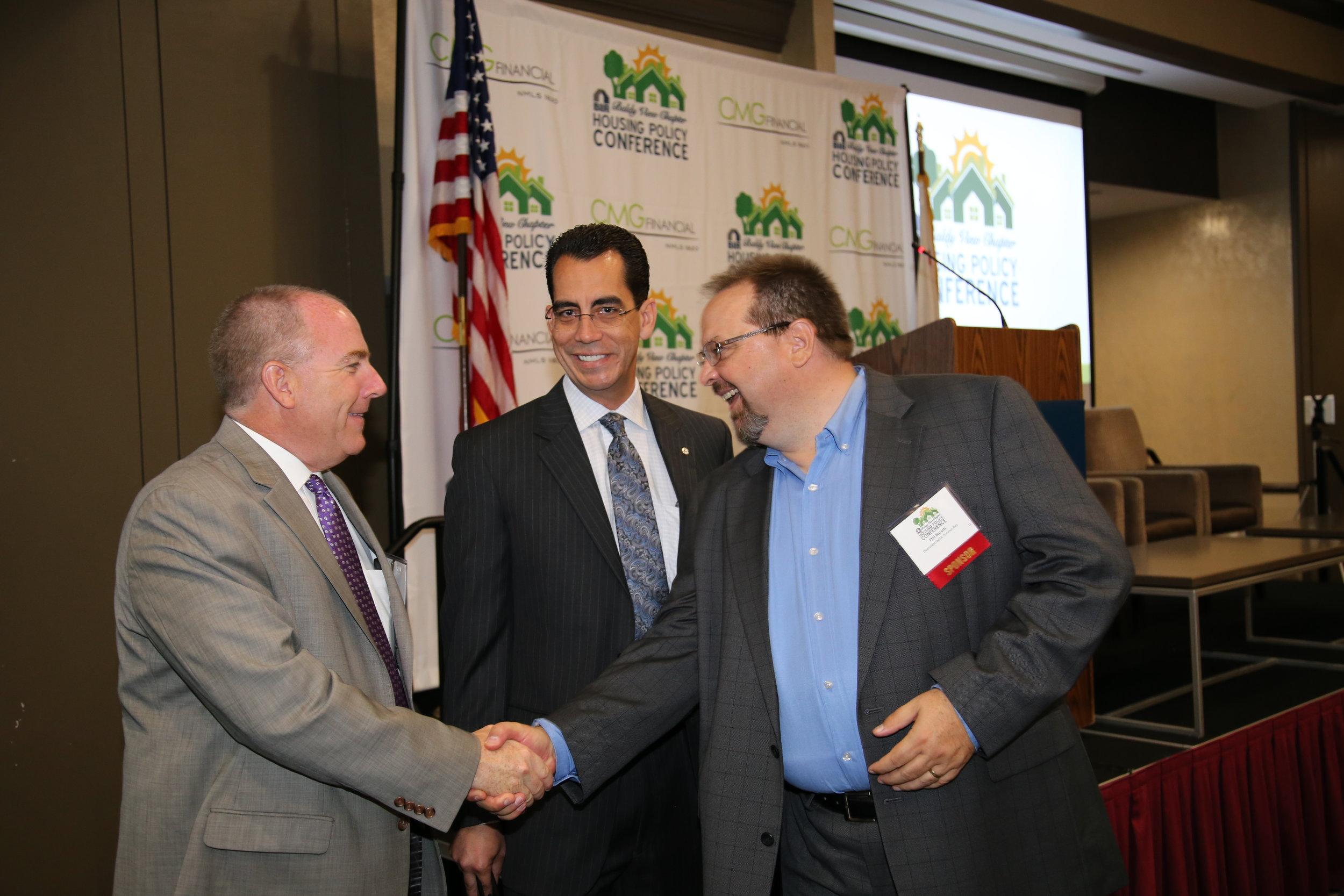 NAHB VP Lake Coulson greets BIABV President Phil Burum along with BIABV CEO Carlos Rodriguez (center)