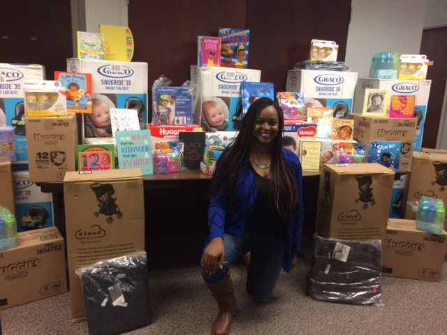 Alexis Davis with all of the items she was able to purchase from the MomsFirst Wishlist on Amazon.com with the money she raised in December, 2017.