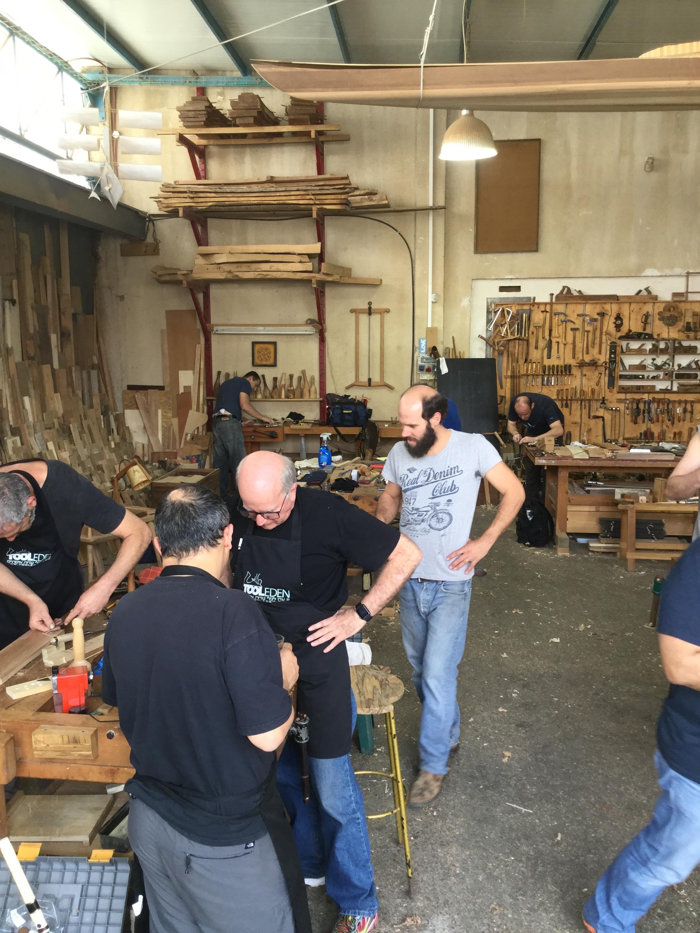 Gil (with beard) runs the shop
