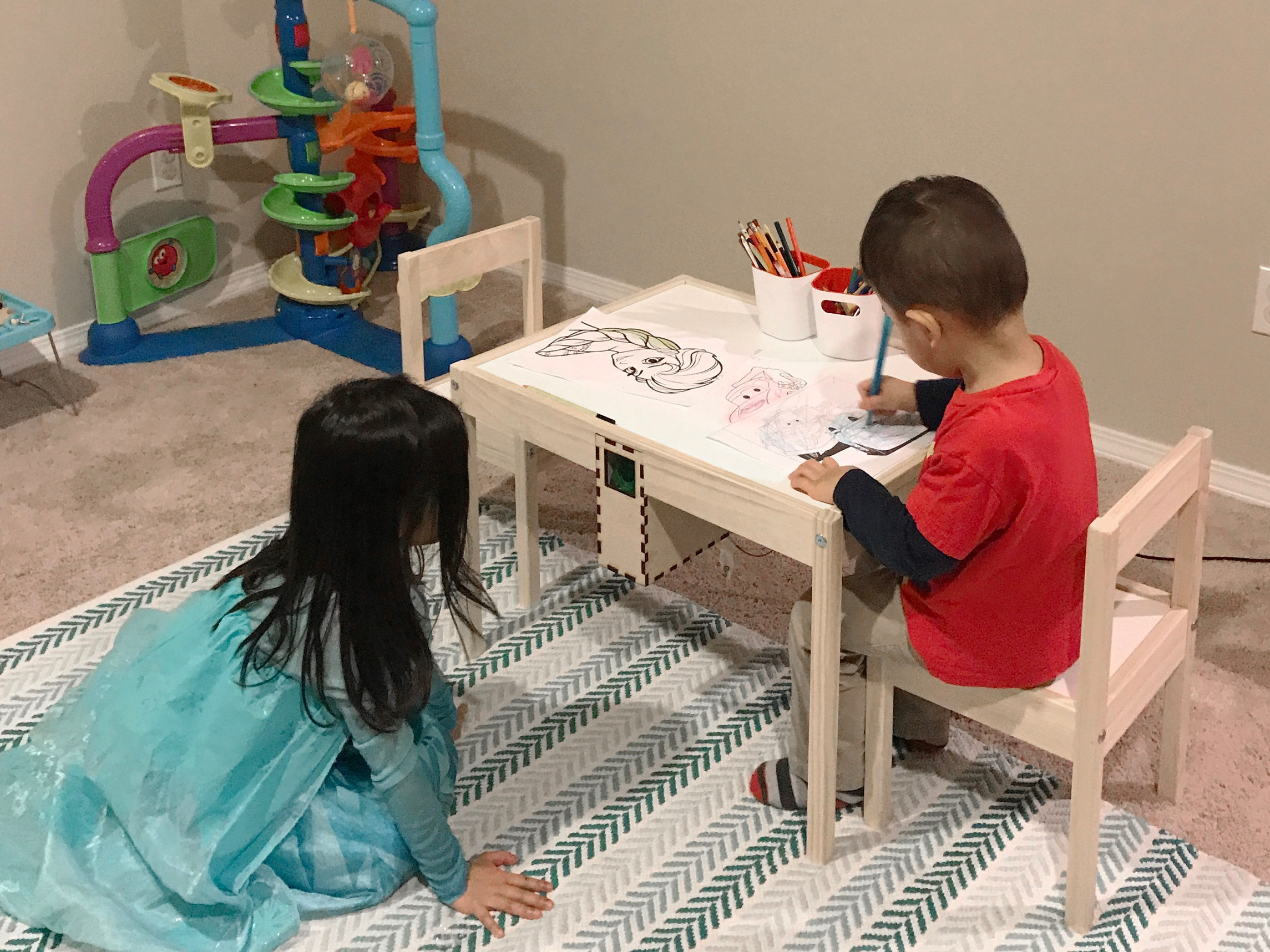 A kids' table that can actuate bubbles as someone hugs the pillow remotely.