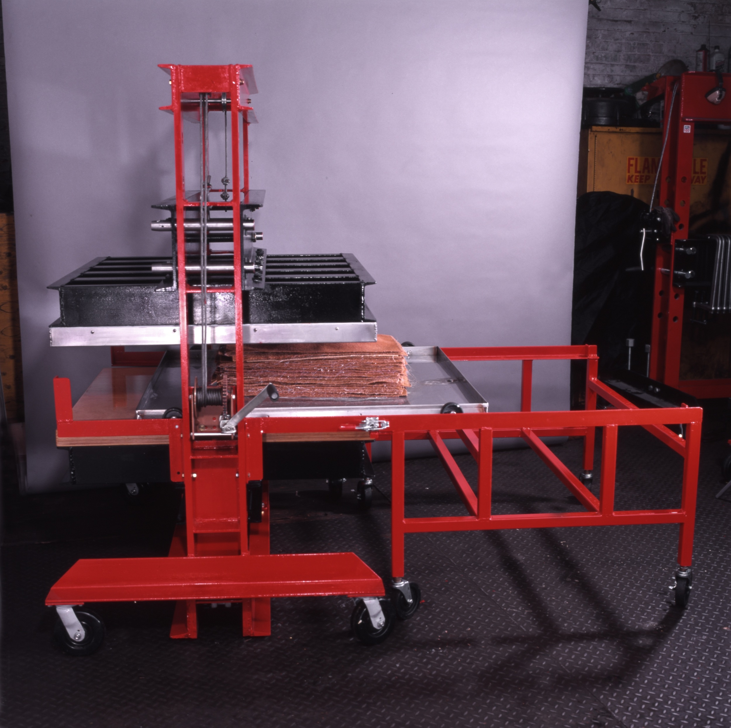 50-ton hydraulic press and rolling cart