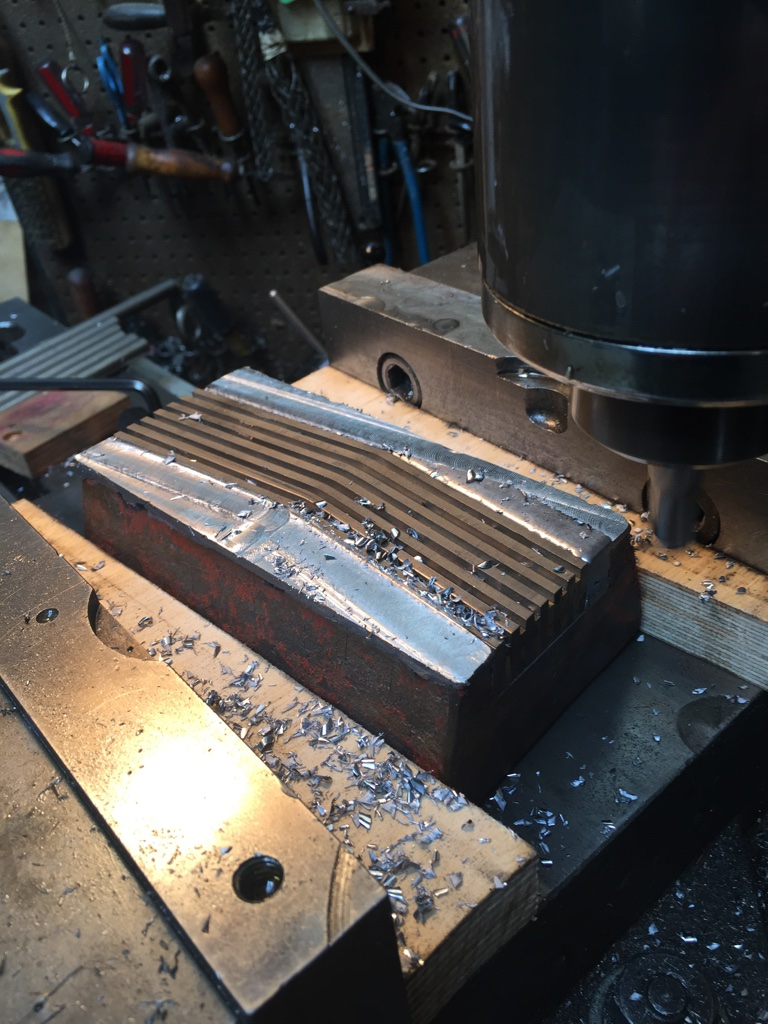 Milling blade retaining metal