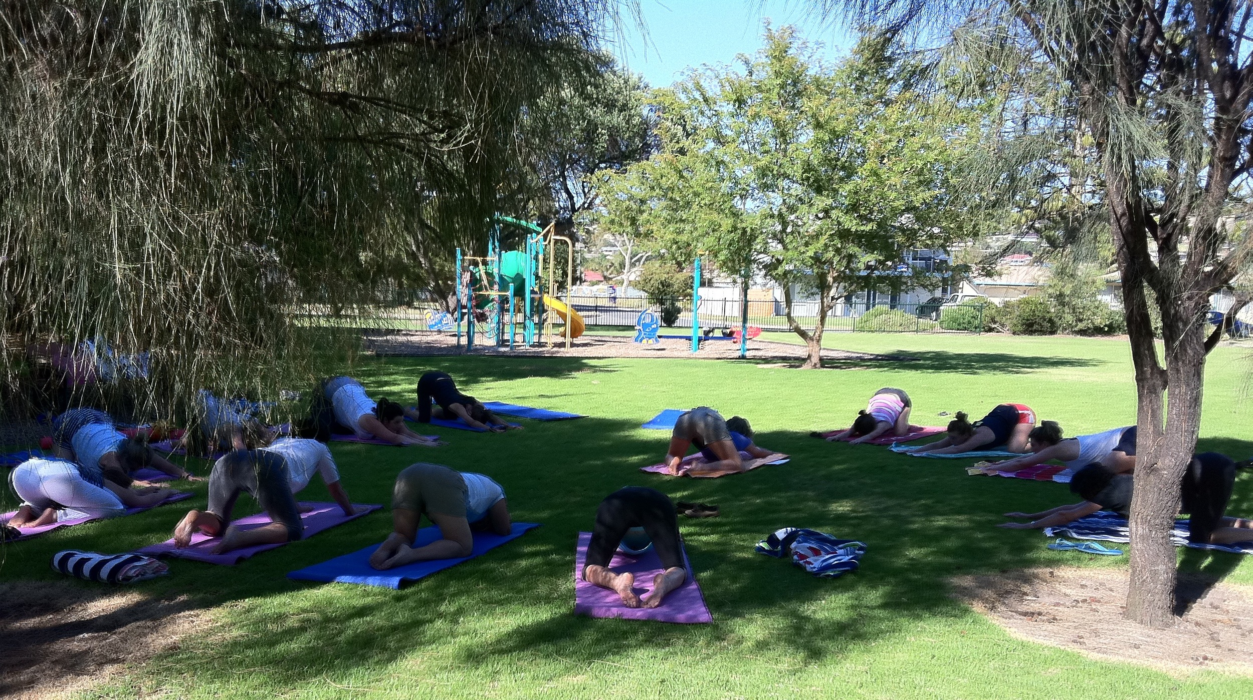 An outdoor yoga class during Eliza Ballard Yoga's last visit to Encounter Bay, Victor Harbour, South Australia