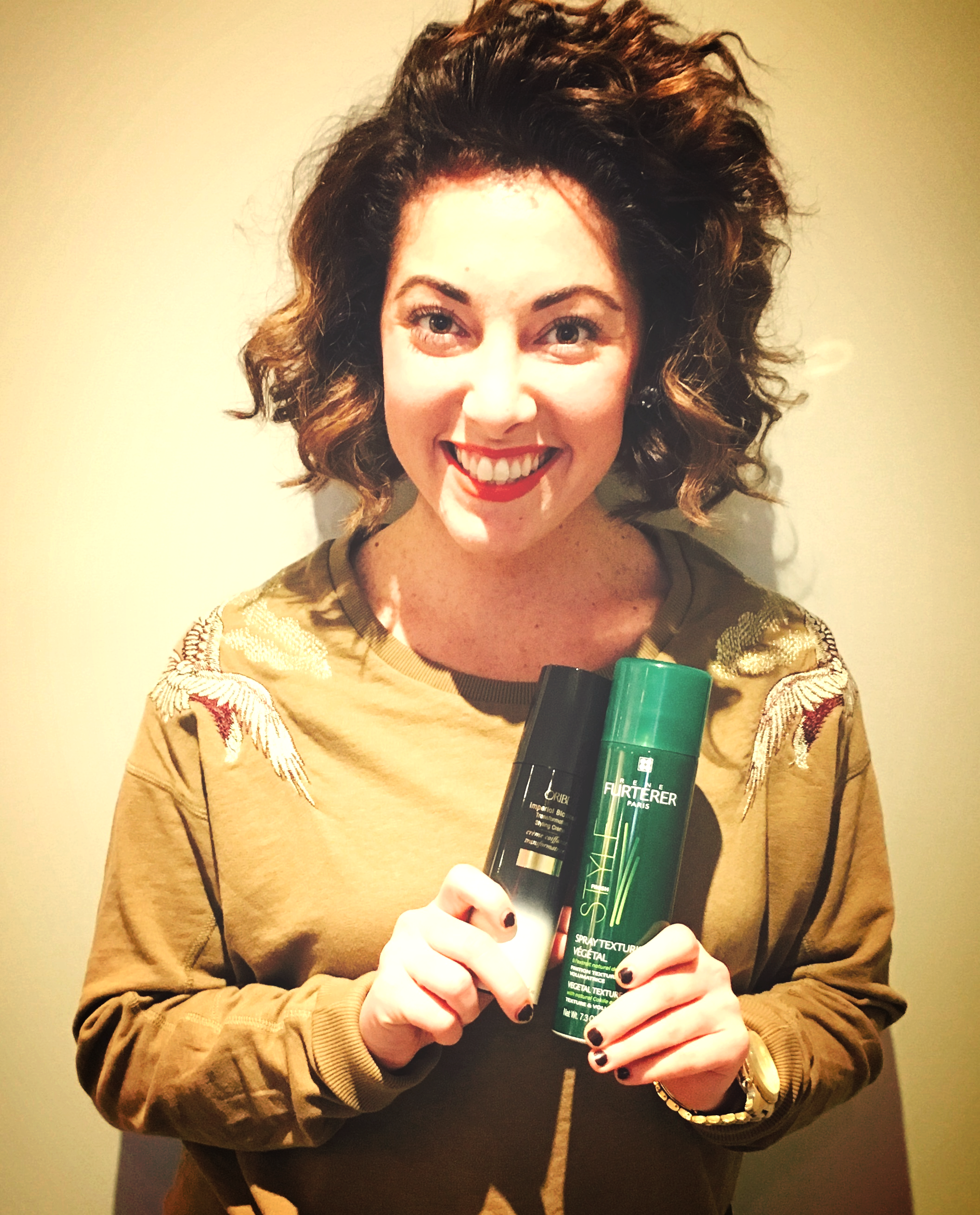 Jess with her two favorite products of the week, Imperial Blowout by Oribe and Rene Furterer's Vegetal Texture Spray.