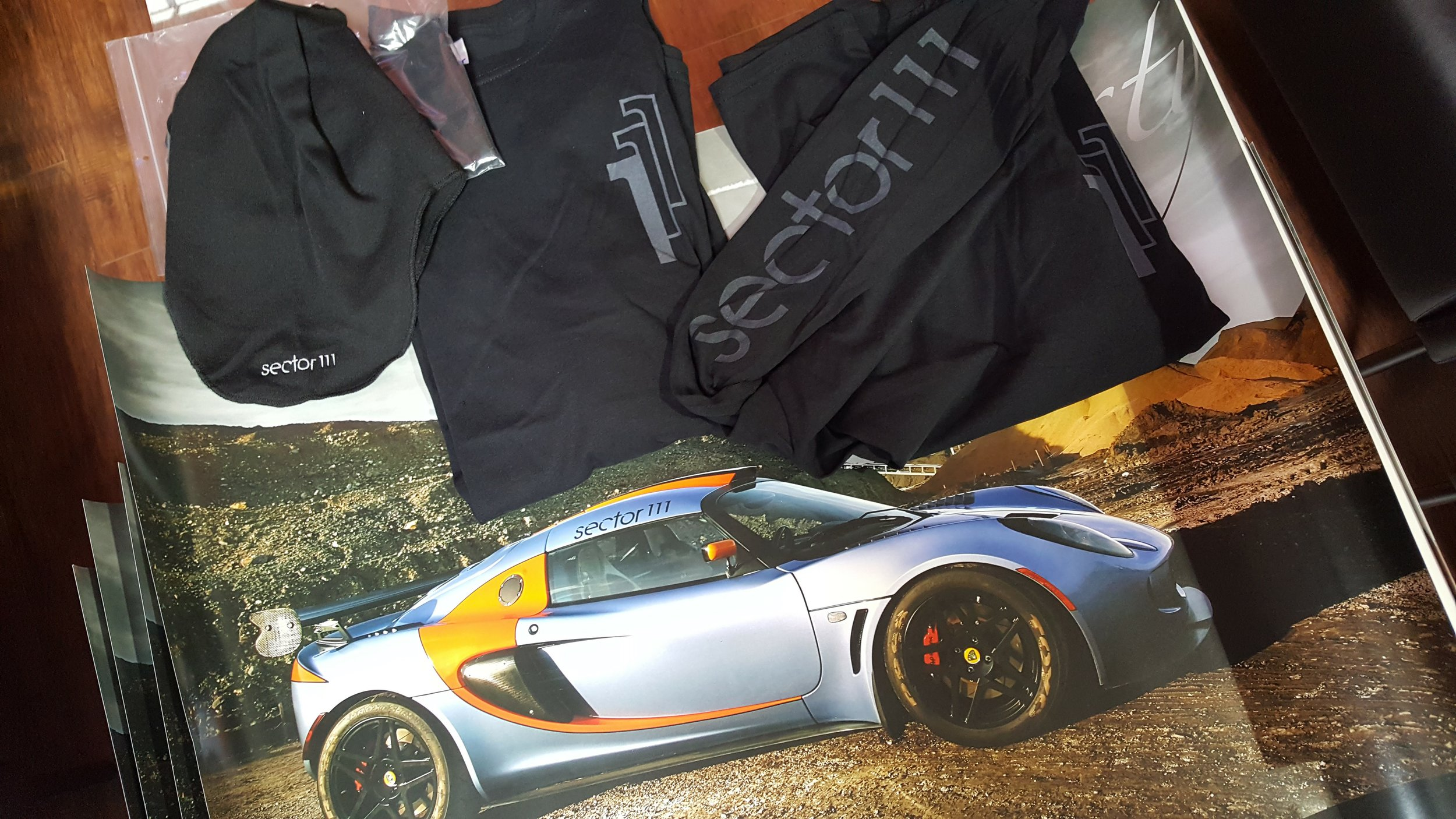 Sector 111  Package: includes 1 long sleeve, 1 balaclava, 1 Exige poster. Estimated value: $80. 1 winner. / 3 posters. Estimated value: $10 each. 3 winners.