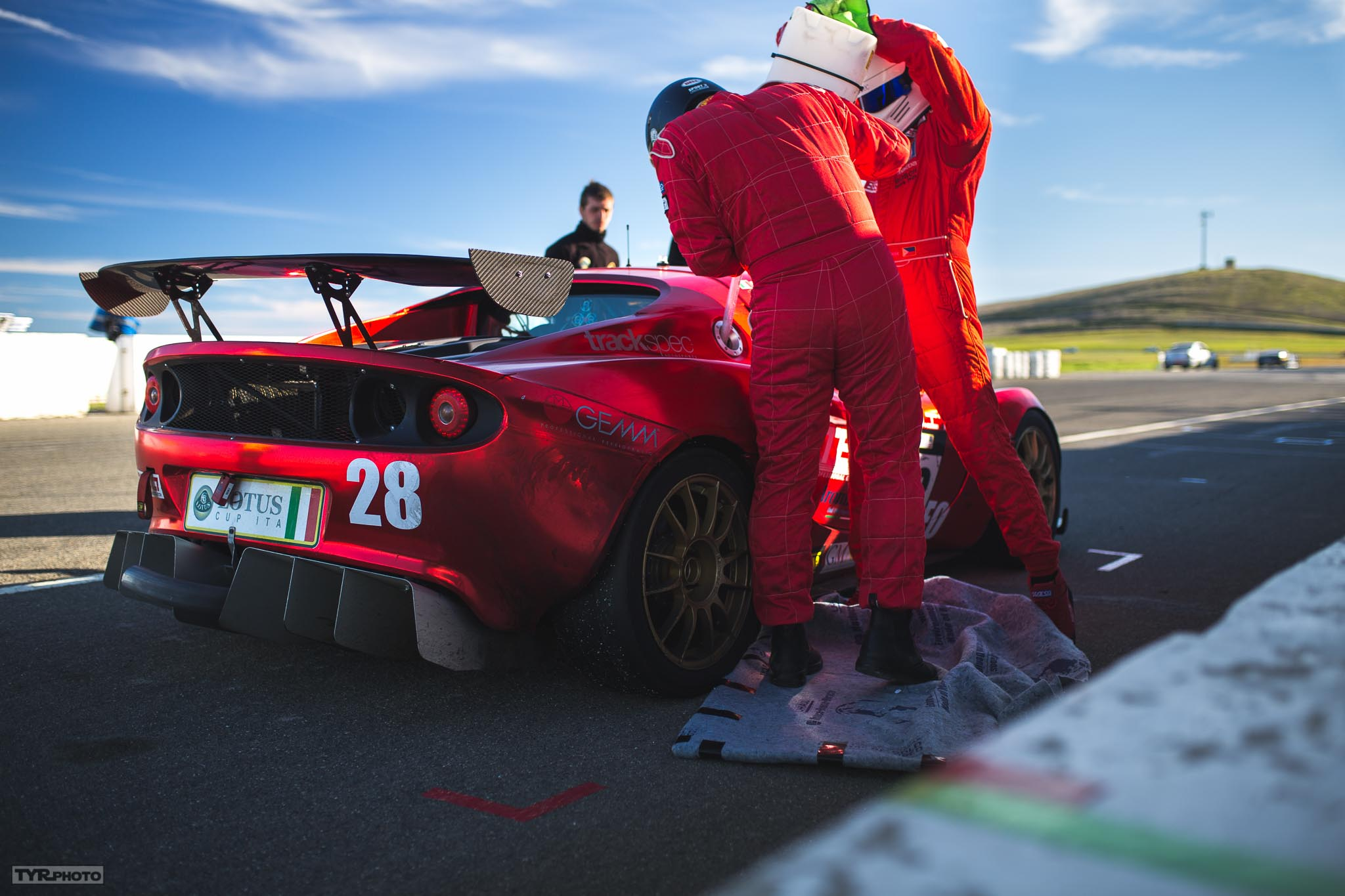 Aidan & Son fueling during a pit stop. Luca in the background making sure the car is okay. PC:  Trevor Ryan