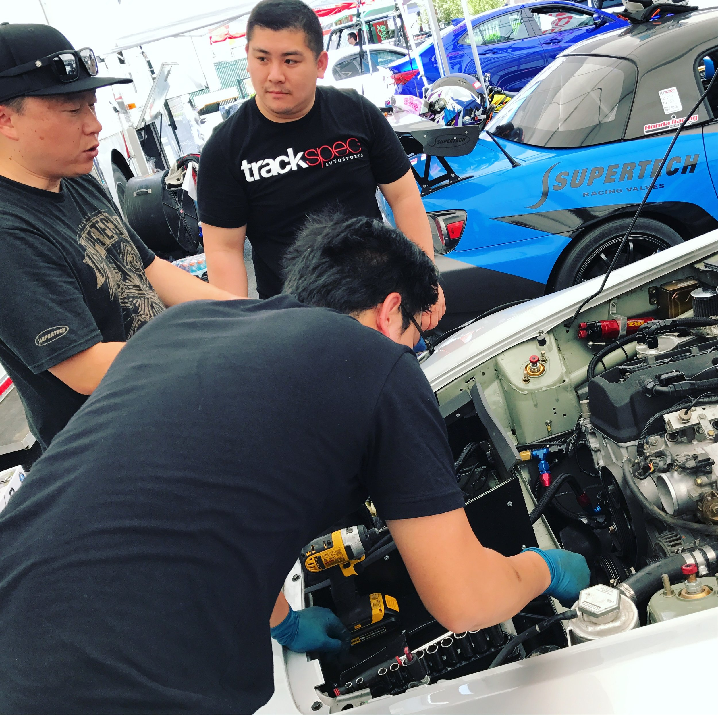 Drew and Son working with my friend and master engine tuner, Jei Chang from Blacktrax Performance