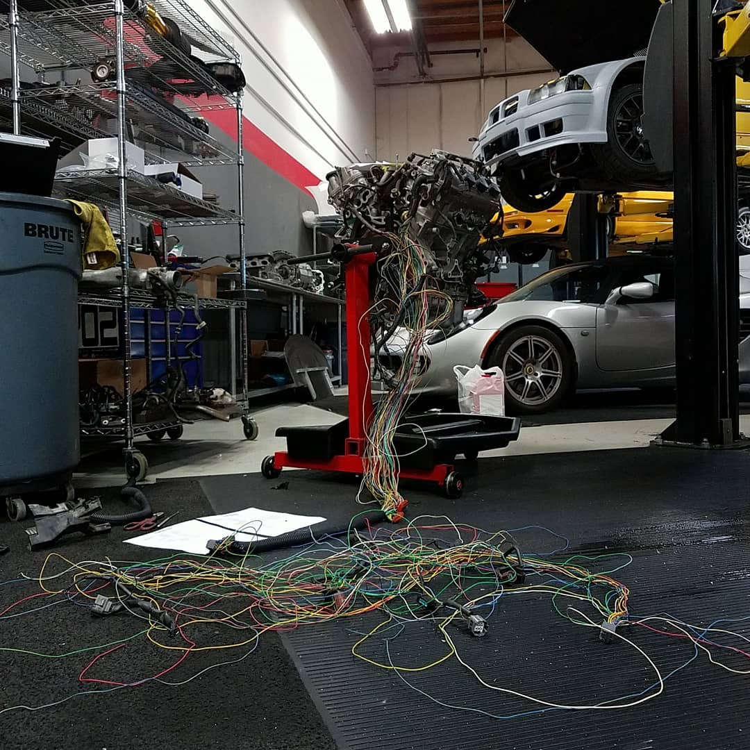 Removing unwanted wiring for automatic transmission controls and emissions components.